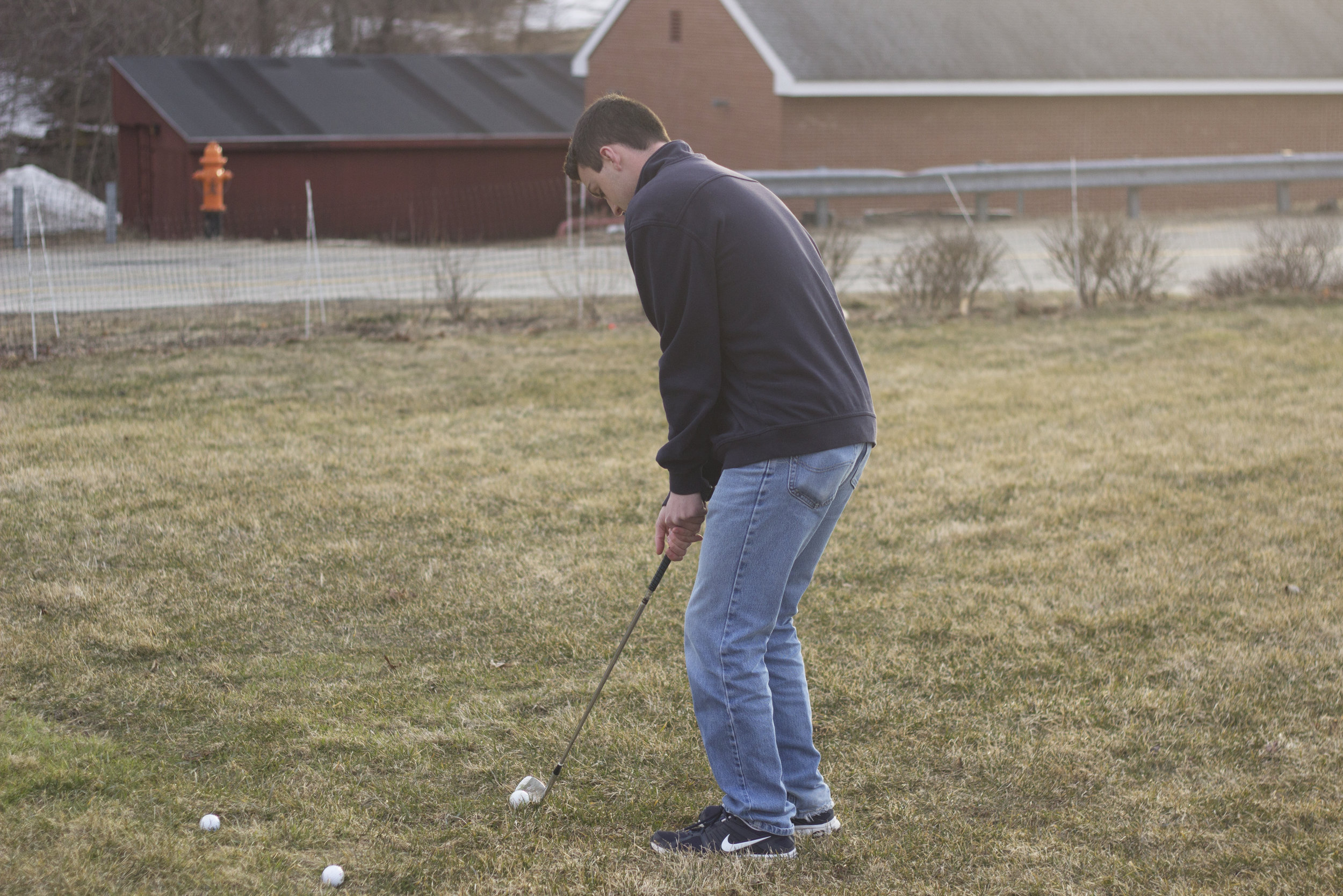 A member of the UConn golf team practices his shot. (File Photo/The Daily Campus)