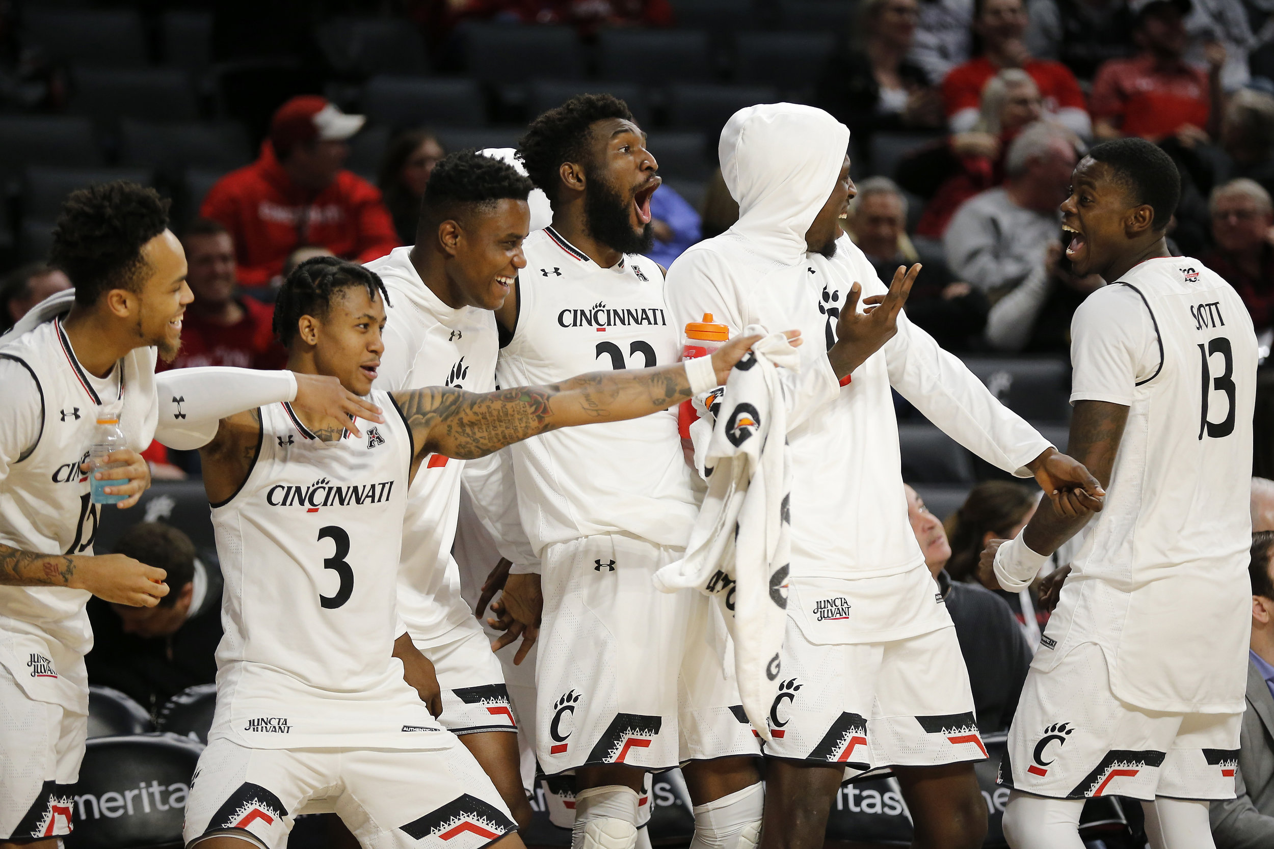 The Cincinnati Bearcats bench reacts after forward Mamoudou Diarra scores from 3-point range in a game against Arkansas-Pine Bluff on Tuesday, Nov. 27 in Cincinnati. (Sam Greene/The Cincinnati Enquirer via AP)