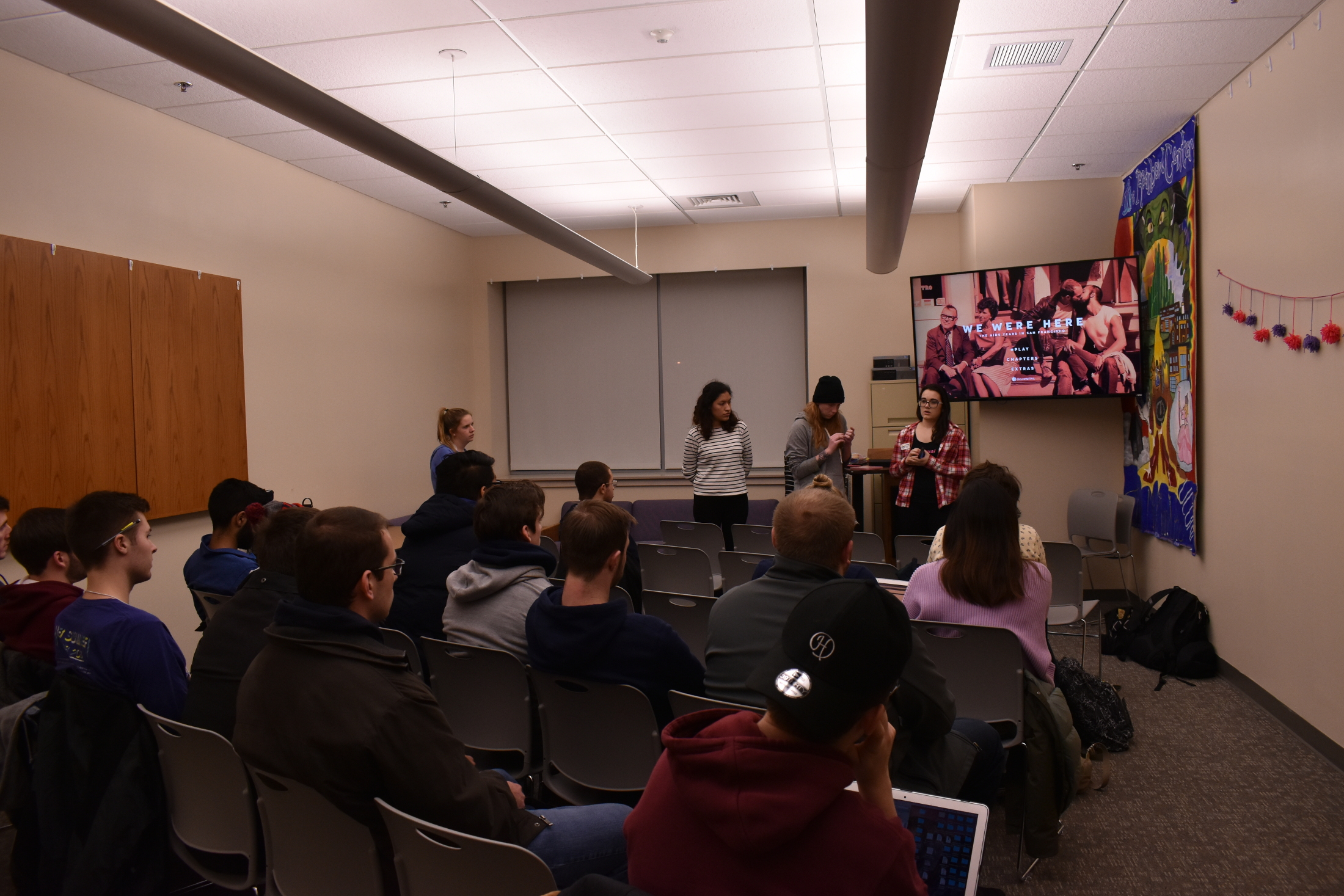 Students watch a documentary about the AIDS epidemic that was heavily prevalent in the 80s. Afterwards, they wrote possible solutions towards ending the AIDS epidemic on paper hearts (Brandon Barzola/The Daily Campus.