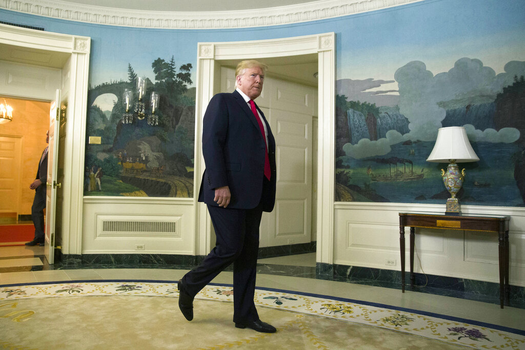 President Donald Trump arrives to speak about the partial government shutdown, immigration and border security in the Diplomatic Reception Room of the White House, in Washington, Saturday, Jan. 19, 2019. (AP Photo/Alex Brandon)