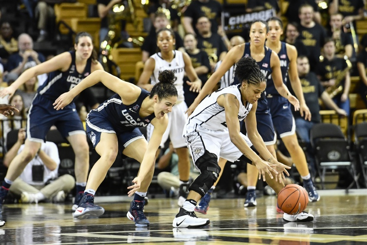Central Florida guard Aliyah Gregory (22) fights to keep possession away from Connecticut guard Kia Nurse (11) during the first half of an NCAA college basketball game, Sunday, Jan. 1, 2017, in Orlando, Fla. (AP Photo/Roy K. Miller) Roy K. Miller