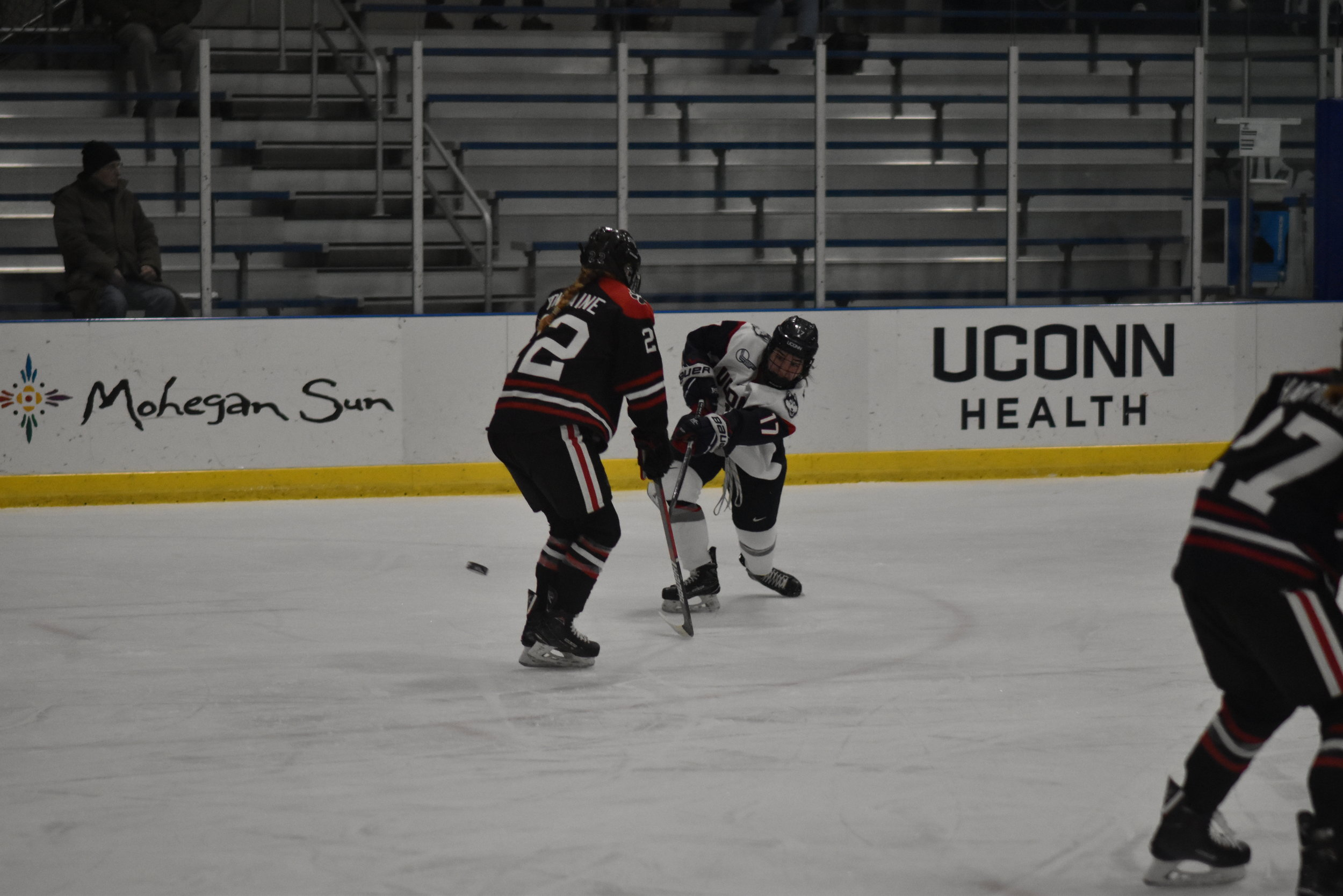 Sophomore Savannah Bouzide (#17) handles the puck in Friday's loss to Northeastern. (Kevin Lindstrom/The Daily Campus)