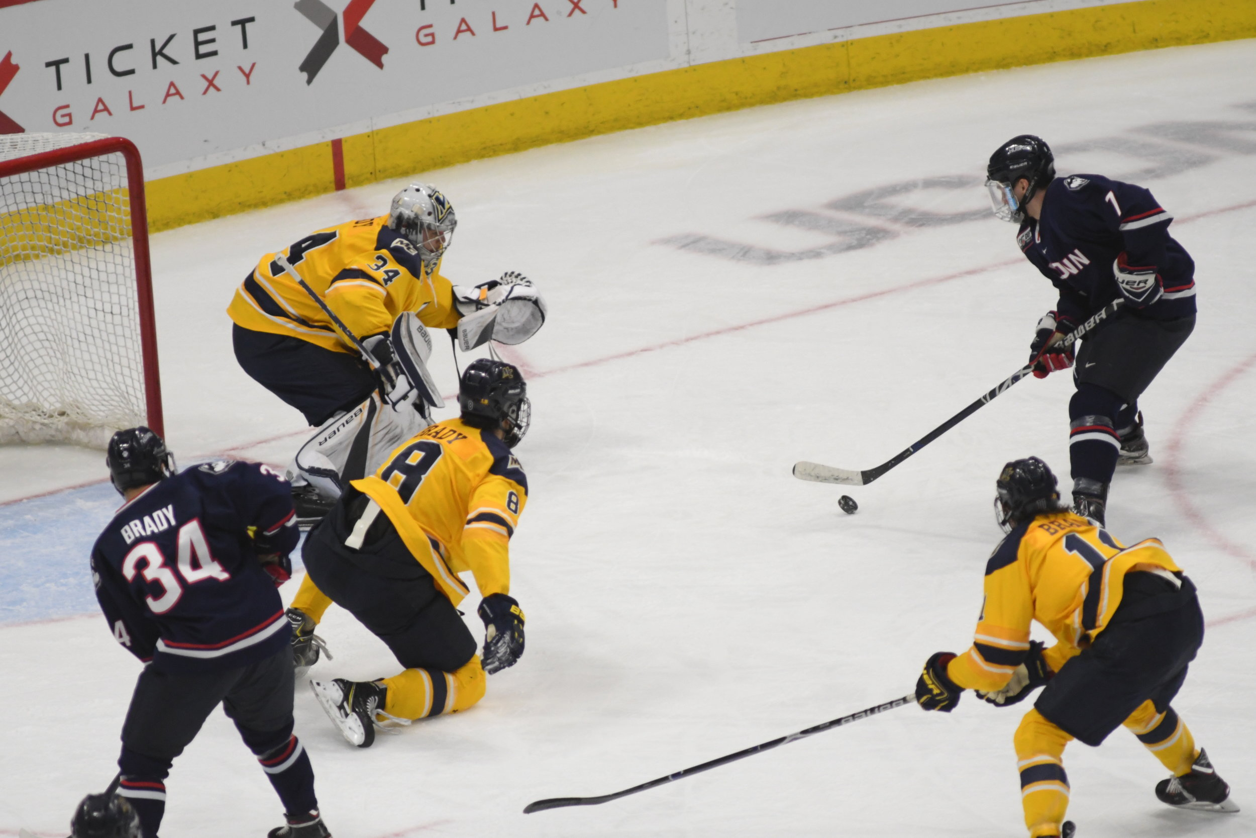 Forward Jonny Evans (#7) gathers for a shot on net in UConn's win over Merrimack. (Kevin Lindstrom/The Daily Campus)