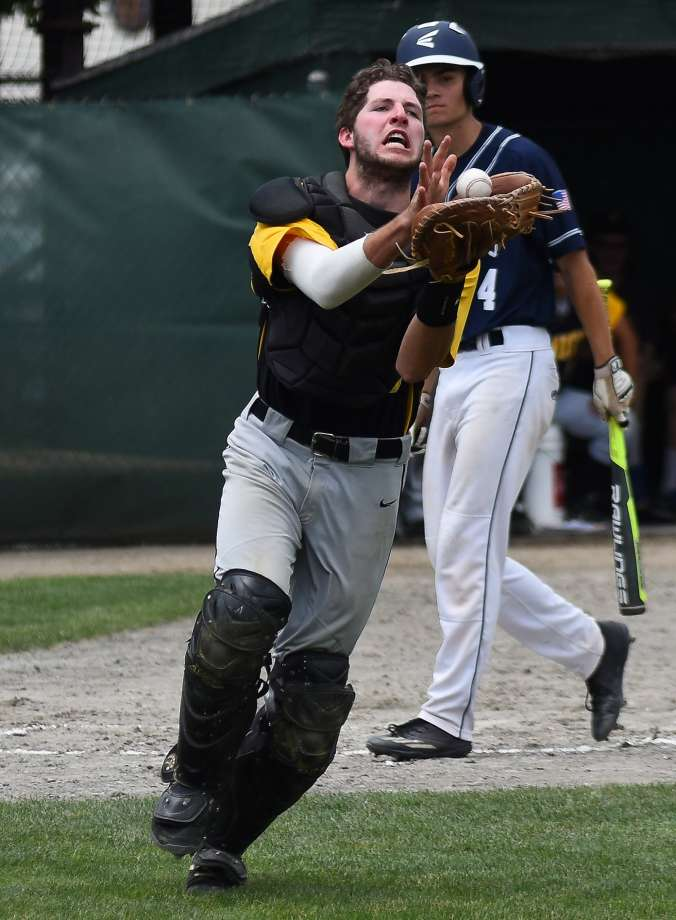 Patrick Winkel makes a play on the ball from his role as a catcher ()
