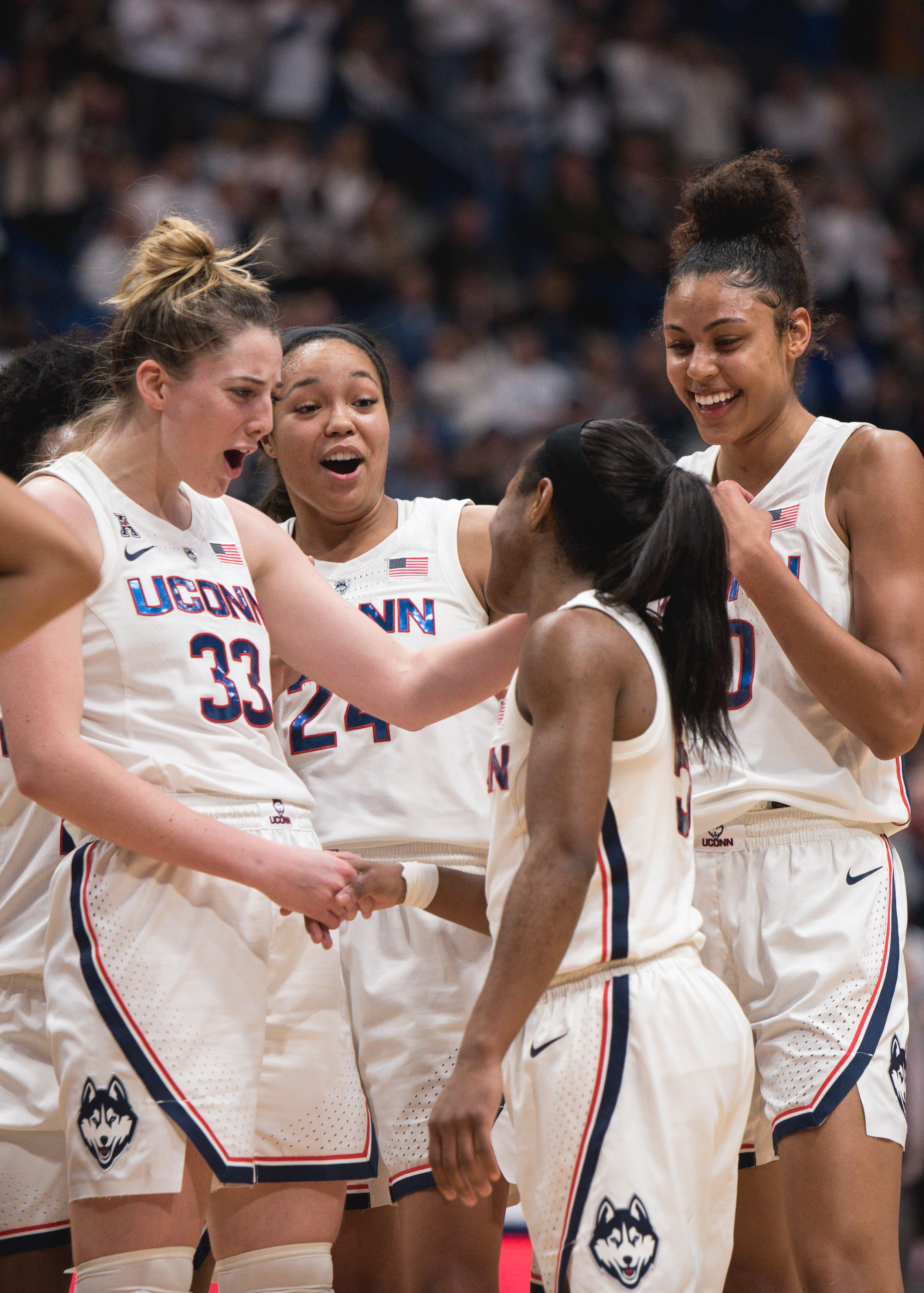The UConn women's team embraces on another during their recent defeat of perennial contender South Carolina (Charlotte Lao/The Daily Campus)