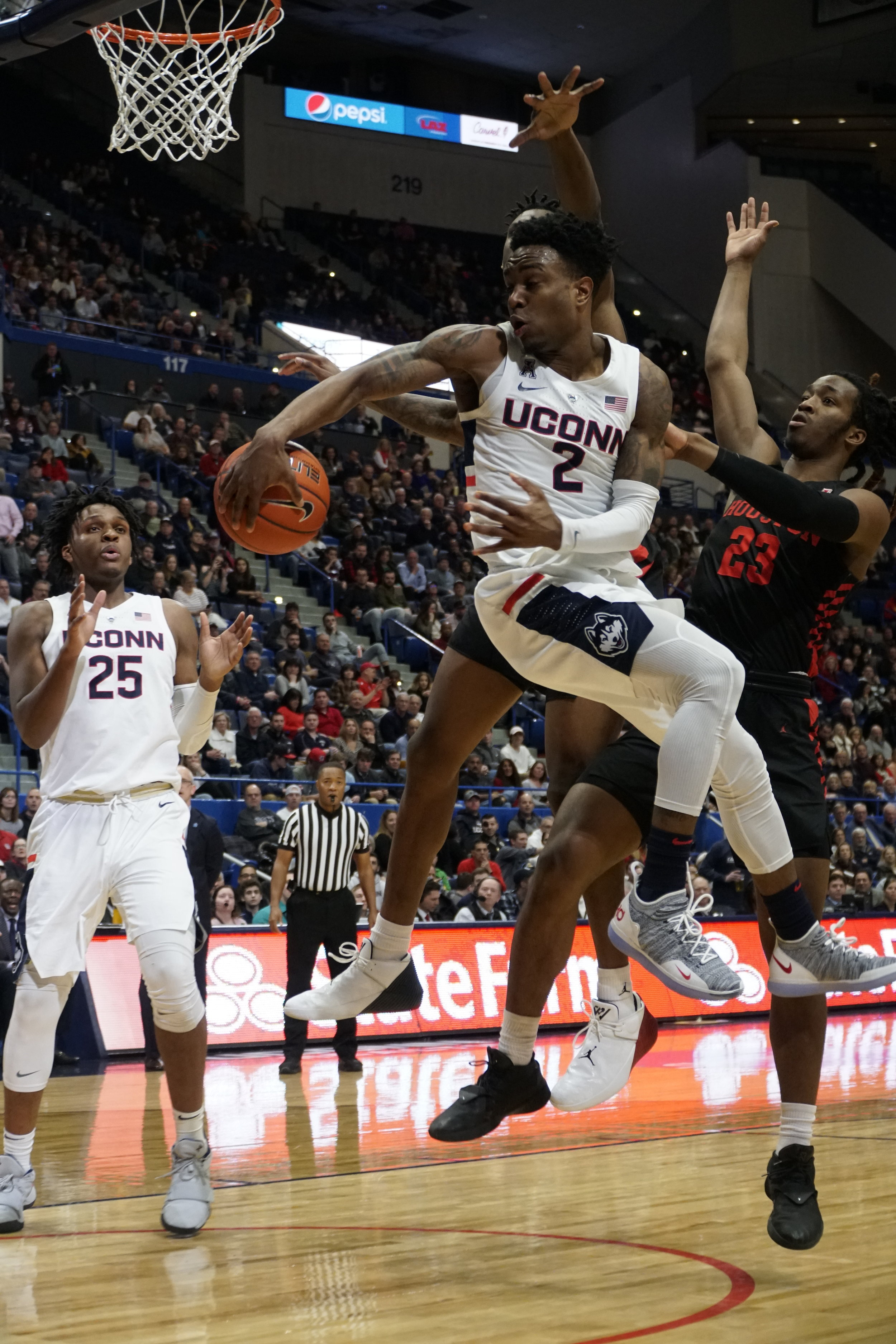 The UConn Huskies took a tough loss at against the Houston Cougars 63-71. Christian Vital (1) and Sidney Wilson (15) lead the team with Sidney scoring a total of 12 points with 2 3-pointers.Their next home game is against University of Cincinnati on 2/24 at the XL Center. (photo by Eric Wang/The Daily Campus)