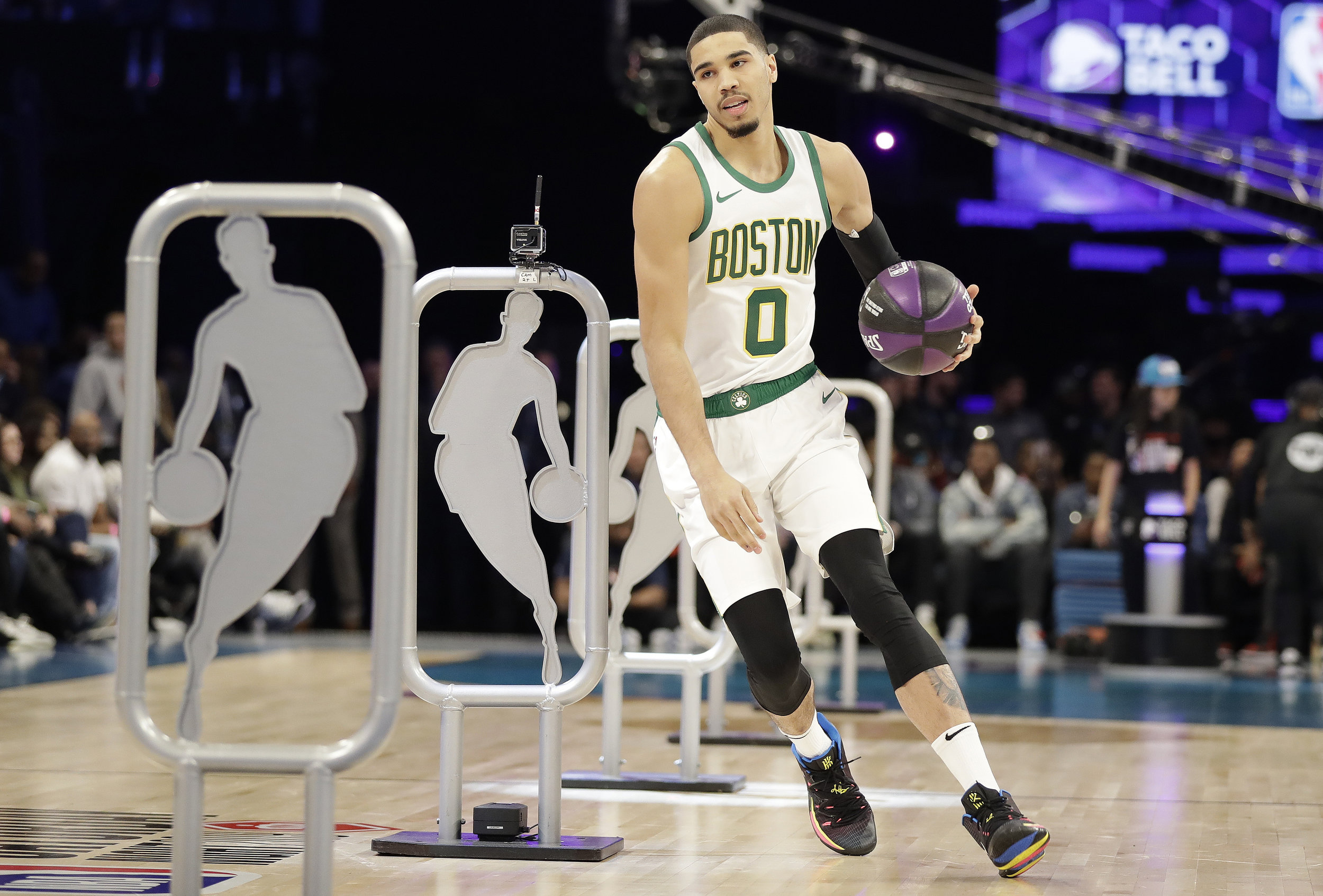 Boston Celtics Jayson Tatum participates during the NBA All-Star skills session basketball contest, Saturday, Feb. 16, 2019, in Charlotte, N.C. (AP Photo/Chuck Burton)