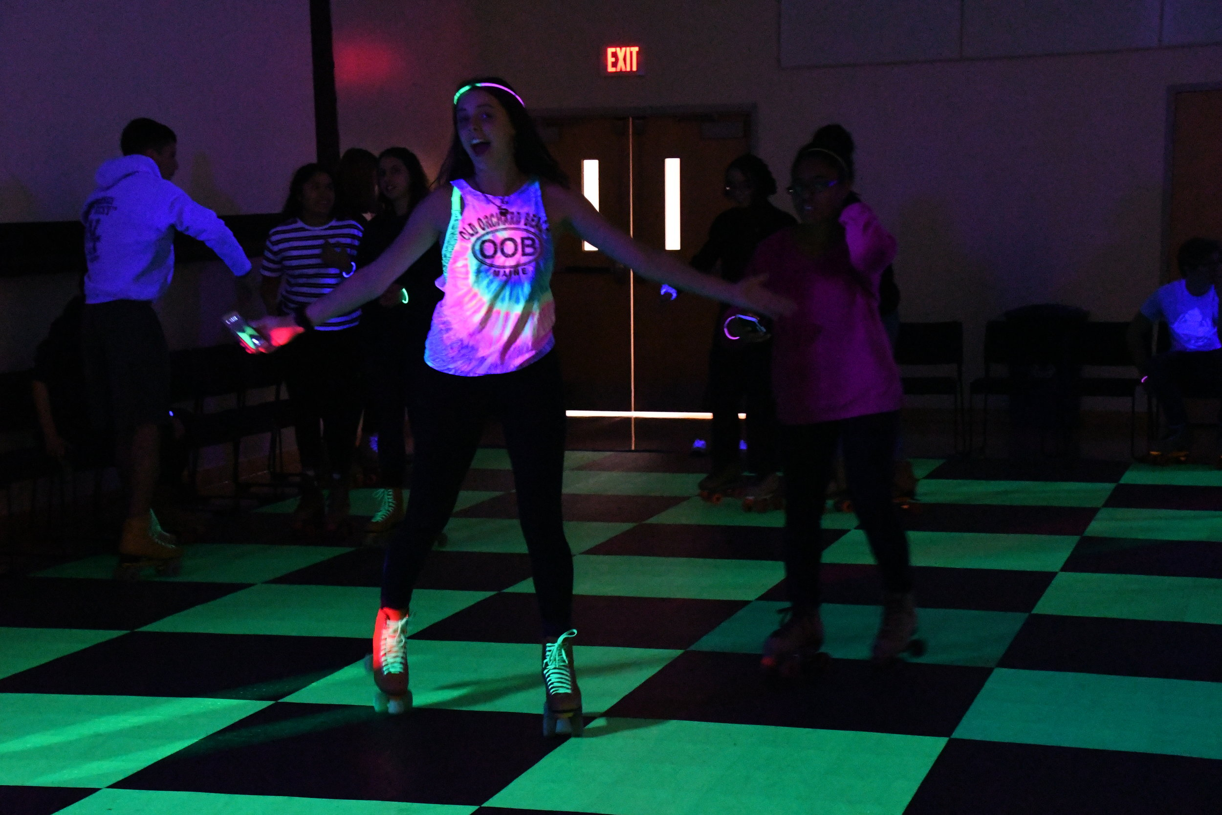 Students roller-skate in the Student Union Ballroom to fun music. SUBOG held this colorful even last night. (Julie Spillane/The Daily Campus)