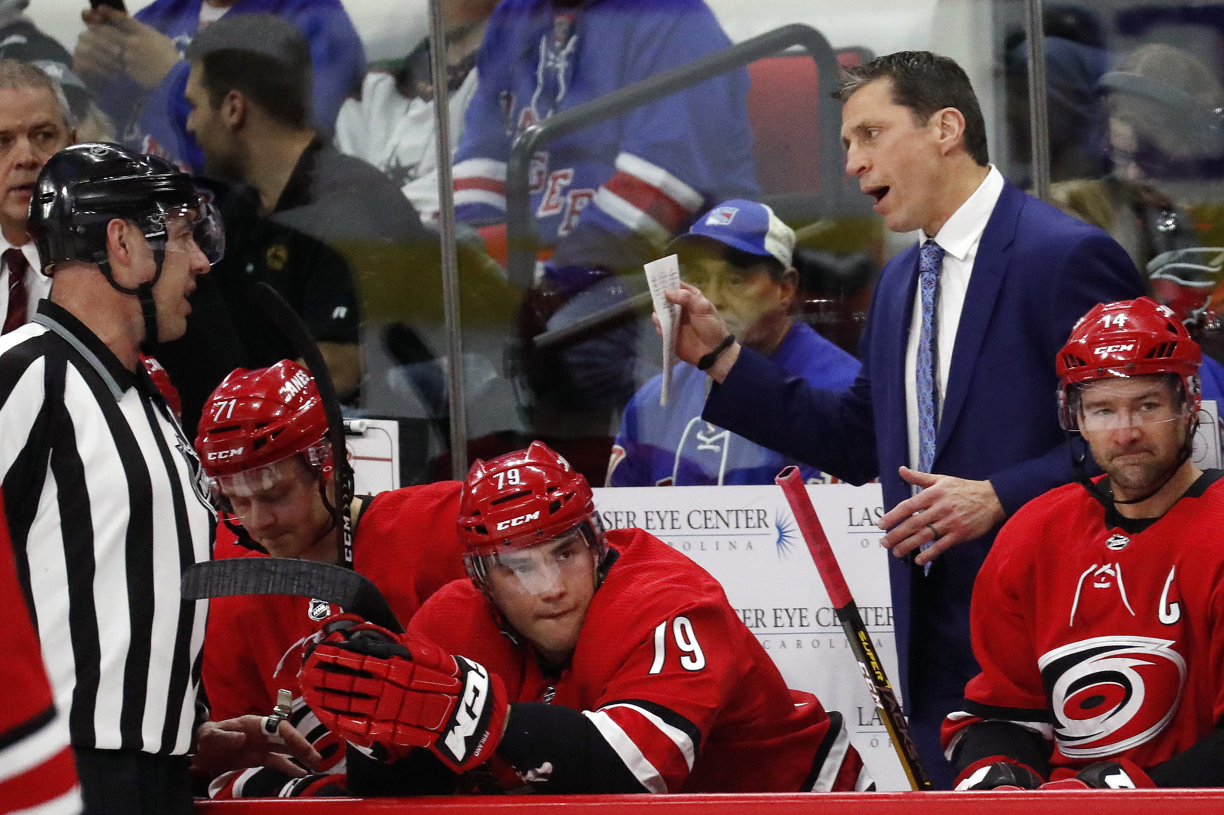Carolina Hurricanes' head coach Rod Brind'Amour talks with an official during a break in the first period of an NHL hockey game against the New York Rangers in Raleigh, N.C., Tuesday, Feb. 19, 2019. (AP Photo/Chris Seward)