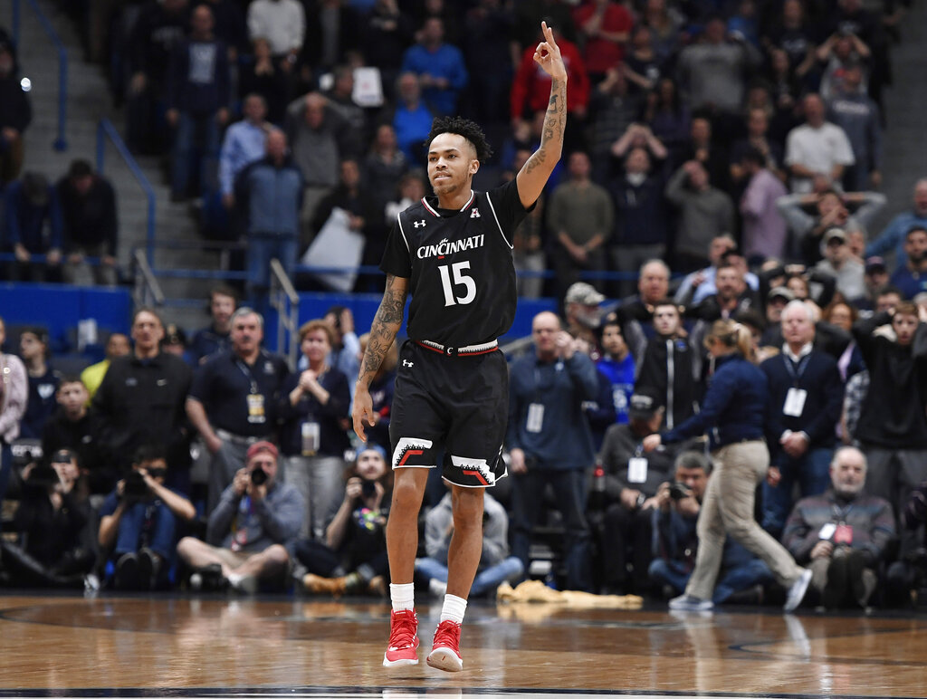 Cincinnati's Cane Broome reacts after making a three-point basket in the final seconds of an NCAA college basketball game against Connecticut, Sunday, Feb. 24, 2019, in Hartford, Conn. (AP Photo/Jessica Hill)