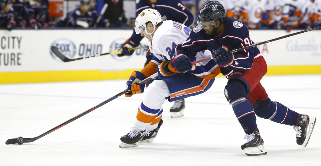 Columbus Blue Jackets' Anthony Duclair, right, tries to stop New York Islanders' Scott Mayfield from shooting during the third period of an NHL hockey game Thursday, Feb. 14, 2019, in Columbus, Ohio. (AP Photo/Jay LaPrete)