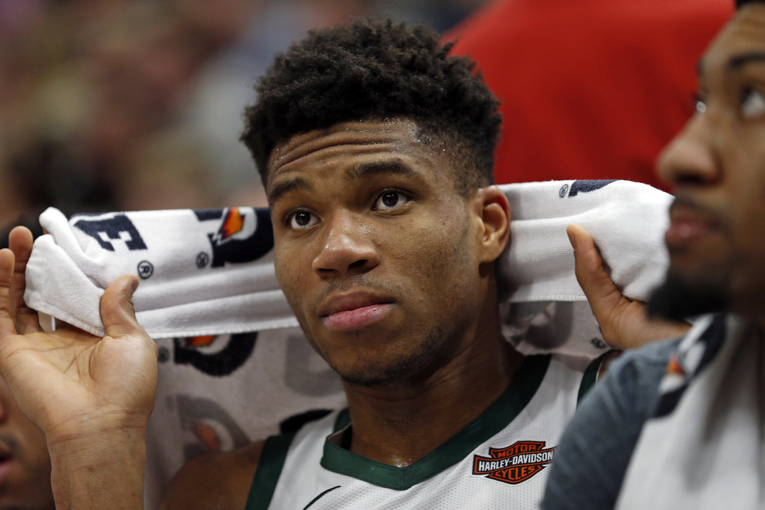 Milwaukee Bucks forward Giannis Antetokounmpo sits on the bench during the second half of an NBA basketball game against the Utah Jazz on Saturday, March 2, 2019, in Salt Lake City. (AP Photo/Rick Bowmer)