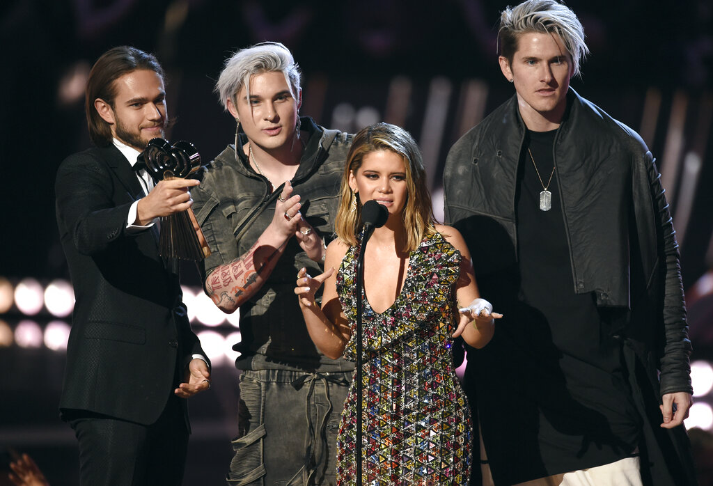 """Michael Trewartha, second left, and Kyle Tree, right, of Grey, Zedd, left, and Maren Morris accept the award for song of the year for """"The Middle"""" at the iHeartRadio Music Awards on Thursday, March 14, 2019, at the Microsoft Theater in Los Angeles. (Photo by Chris Pizzello/Invision/AP)"""