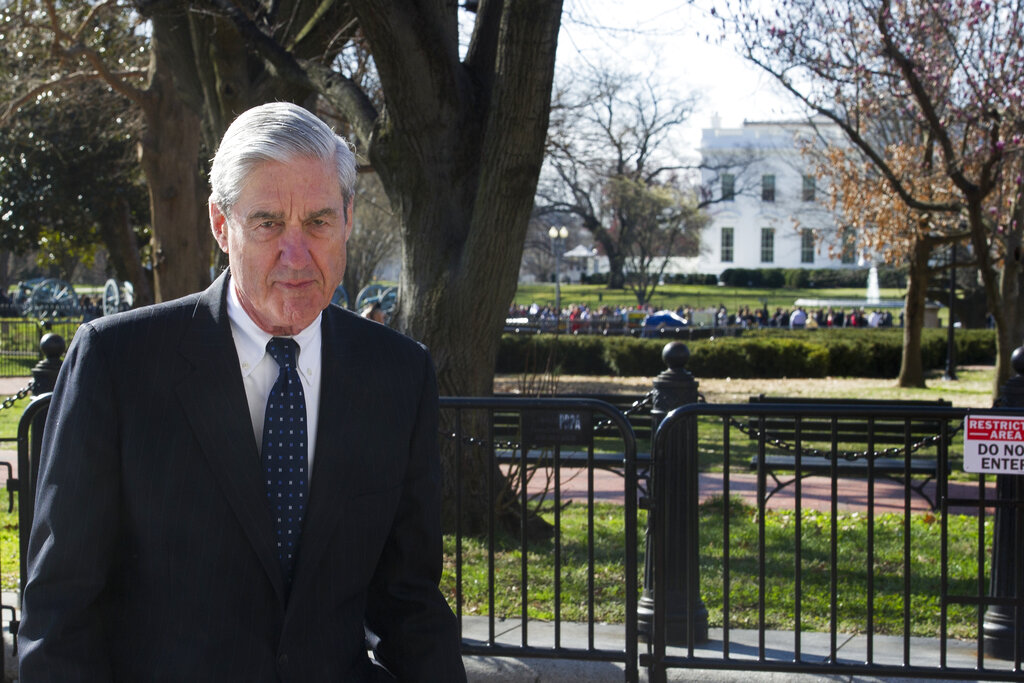 In this March 24, 2019 photo, Special Counsel Robert Mueller walks past the White House, after attending St. John's Episcopal Church for morning services, in Washington. (AP Photo/Cliff Owen)