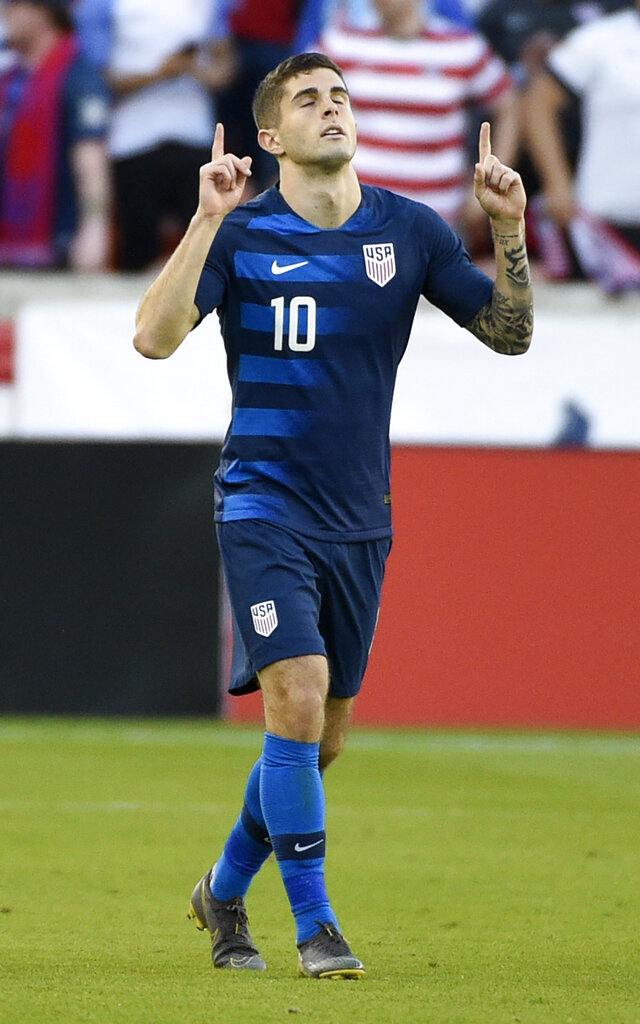 United States midfielder Christian Pulisic celebrates his during the first half of an international friendly soccer match against Chile, Tuesday, March 26, 2019, in Houston. (AP Photo/Eric Christian Smith)