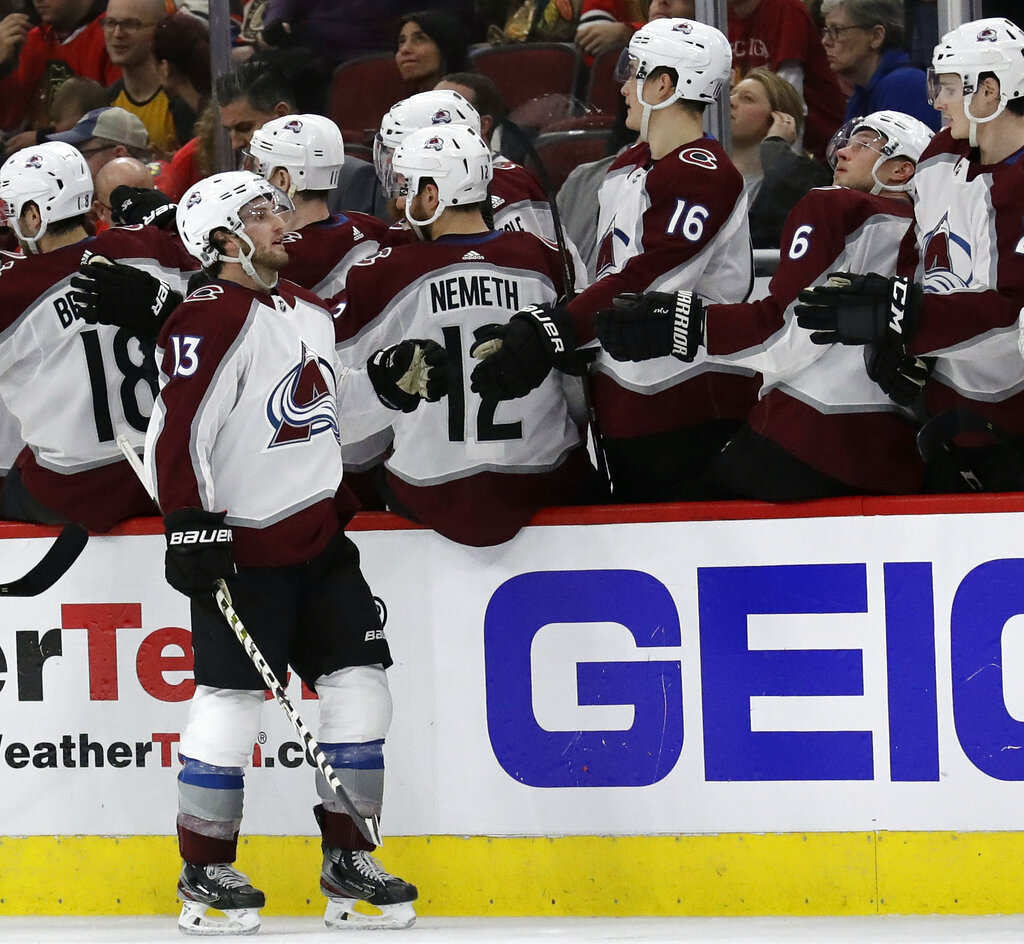 Colorado Avalanche center Alexander Kerfoot (13) celebrates with teammates after scoring a goal during the second period of an NHL hockey game against the Chicago Blackhawks, Sunday, March 24, 2019, in Chicago. (AP Photo/Nam Y. Huh)