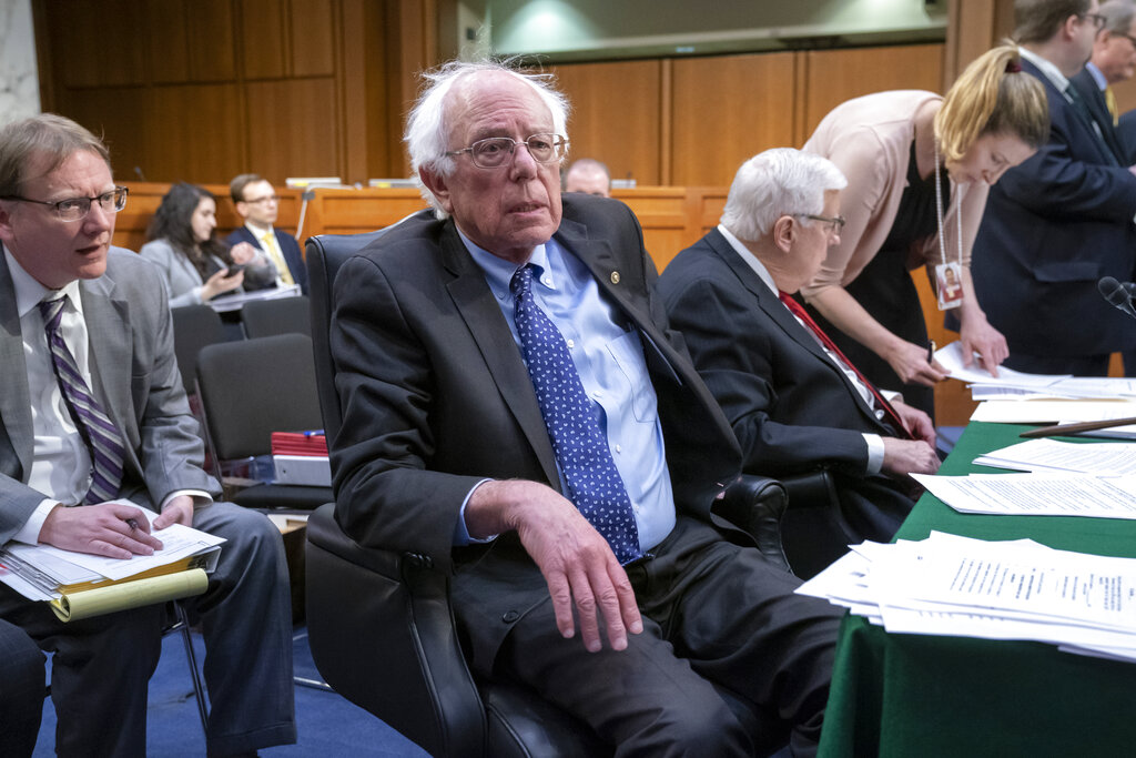 Sen. Bernie Sanders, I-Vt., the top Democrat on the Senate Budget Committee, joined at right by Sen. Mike Enzi, R-Wyo., the chairman, vote on amendments for the fiscal year 2020 budget resolution, on Capitol Hill in Washington, Thursday, March 28, 2019. (AP Photo/J. Scott Applewhite)