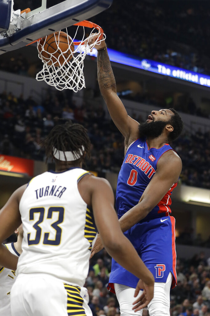 Detroit Pistons' Andre Drummond (0) dunks against Indiana Pacers' Myles Turner (33) during the first half of an NBA basketball game, Monday, April 1, 2019, in Indianapolis. (AP Photo/Darron Cummings)