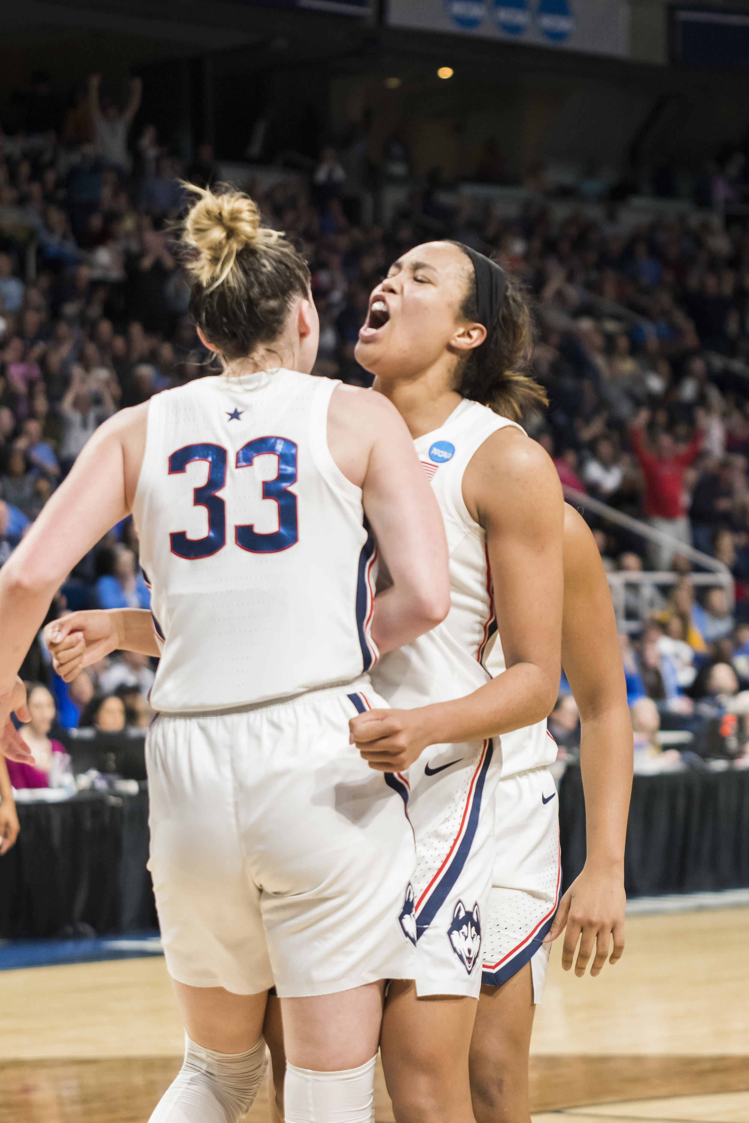 The Huskies continue their march down the tournament as they win against the UCLA Bruins 69-61 on Friday. Napheesa Collier (24), Crystal Dangerfield (5), and Christyn Williams (23) lead the game with 25, 15, and 14 points each. (Photo by Eric Wang/The Daily Campus)
