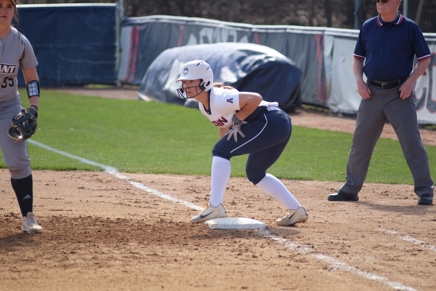 Junior Carli Cutler stands on first base during a home game at Burrill Family Field. (Nicholas Hampton/The Daily Campus)