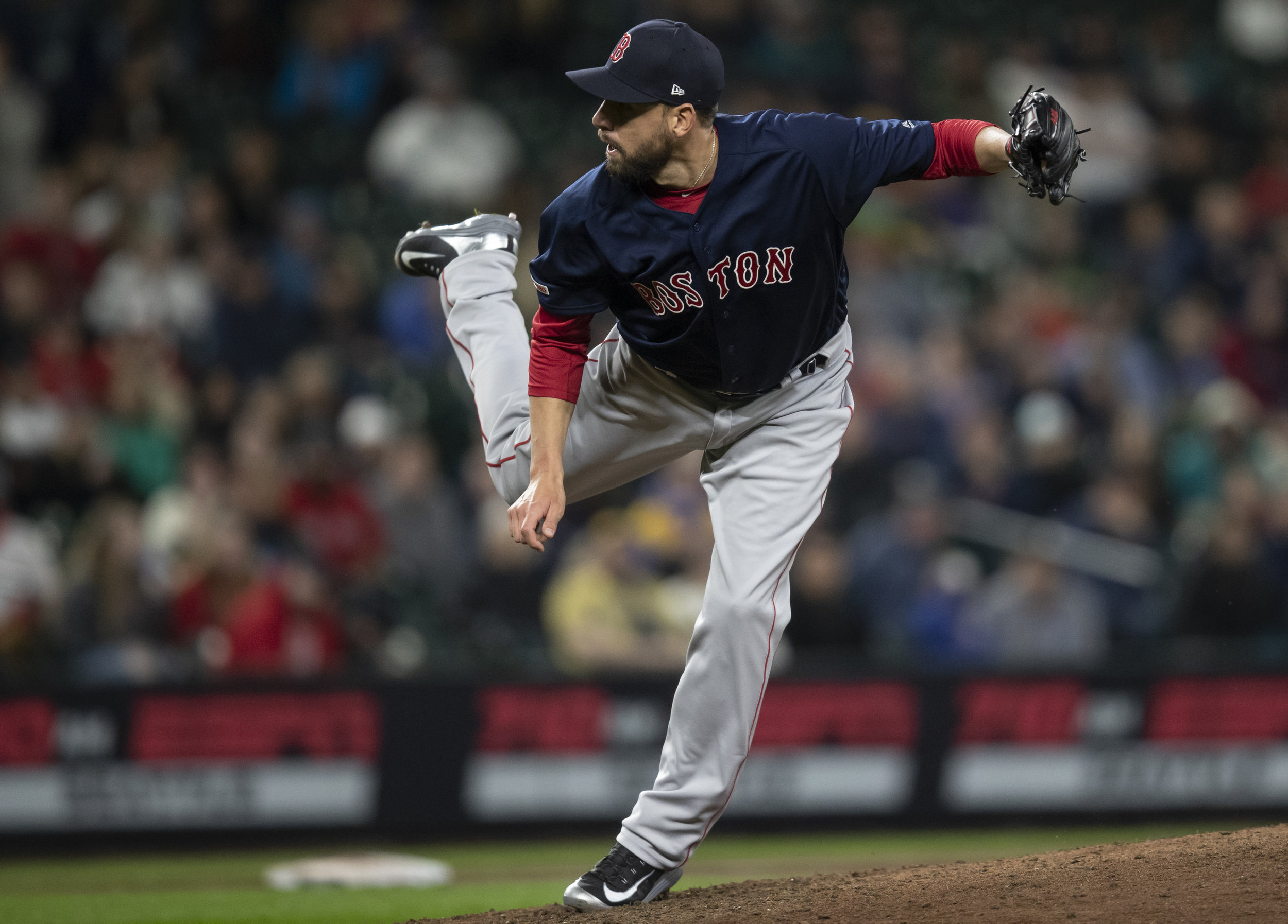 Boston Red Sox reliever Matt Barnes watches a pitch during the ninth inning of the team's baseball game against the Seattle Mariners, Friday, March 29, 2019, in Seattle. The Red Sox won 7-6. (AP Photo/Stephen Brashear)