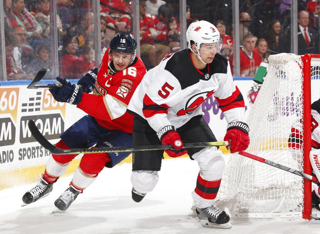 abdb255d5a3 Florida Panthers center Aleksander Barkov (16) pursues New Jersey Devils  defenseman Connor Carrick (