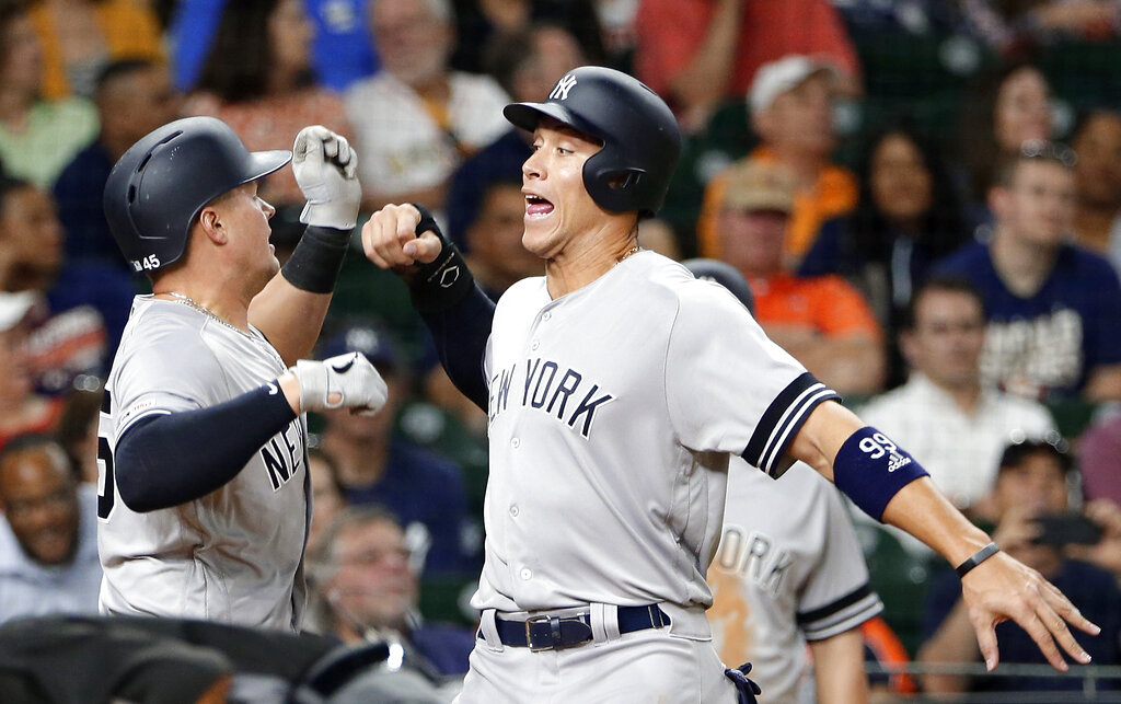 New York Yankees' Luke Voit, left, and Aaron Judge, right, celebrate Voit's two run home run during the eighth inning of a baseball game against the Houston Astros on Wednesday, April 10, 2019, in Houston. (AP Photo/Michael Wyke)