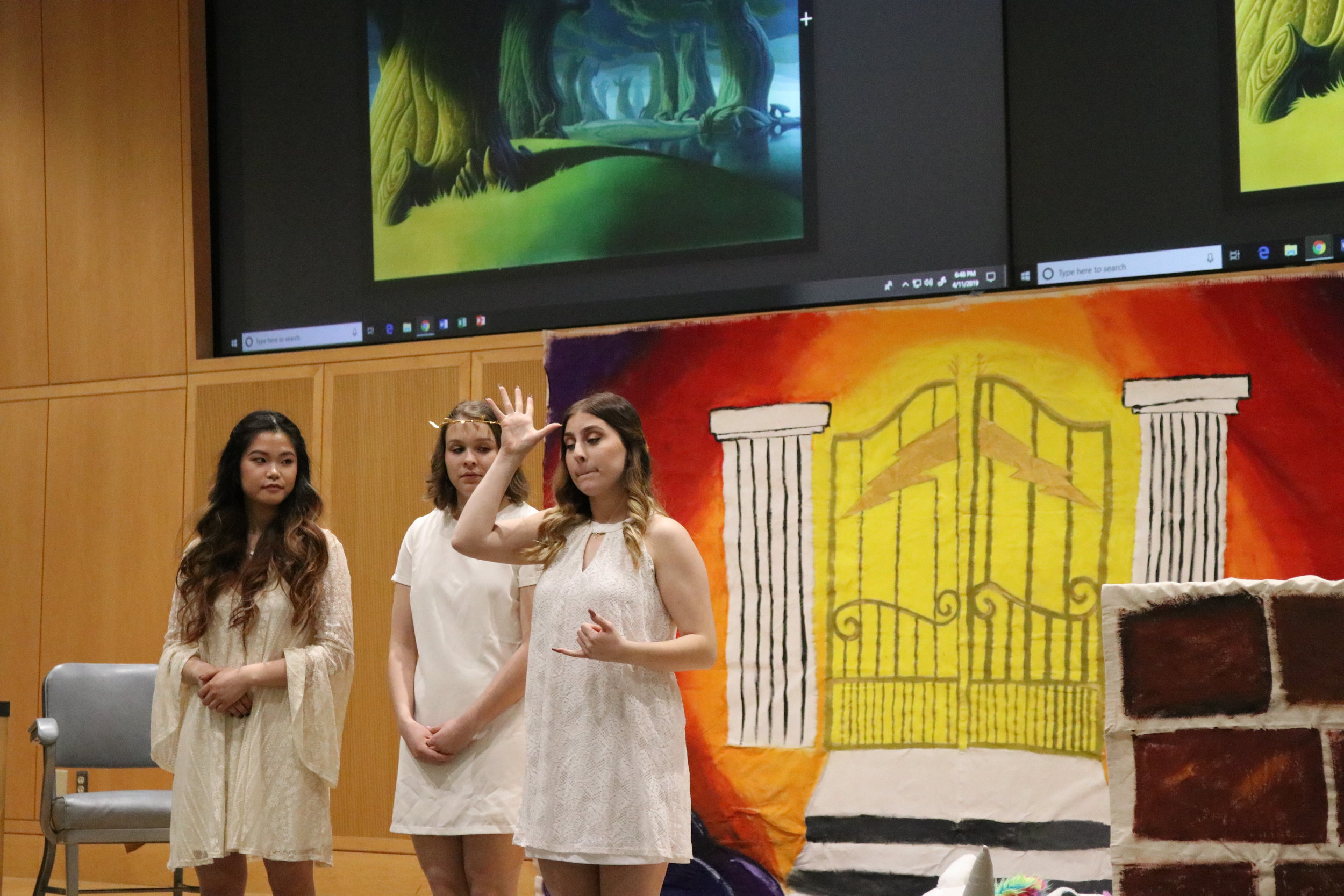 """The UConn American Sign Language club puts on a show for students and community members during Deaf Awareness Day on Thursday night. Students from the ASL 4 class worked for months to create a play version of """"Hercules"""" in American Sign Language for the audience to enjoy (Maggie Chafouleas)"""