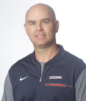 Caddy heads up the Huskies' defensive unit and player development programs, where he has cultivated multiple All-Americans and Big East Defensive Players of the Year.  (Image via UConn Athletics)