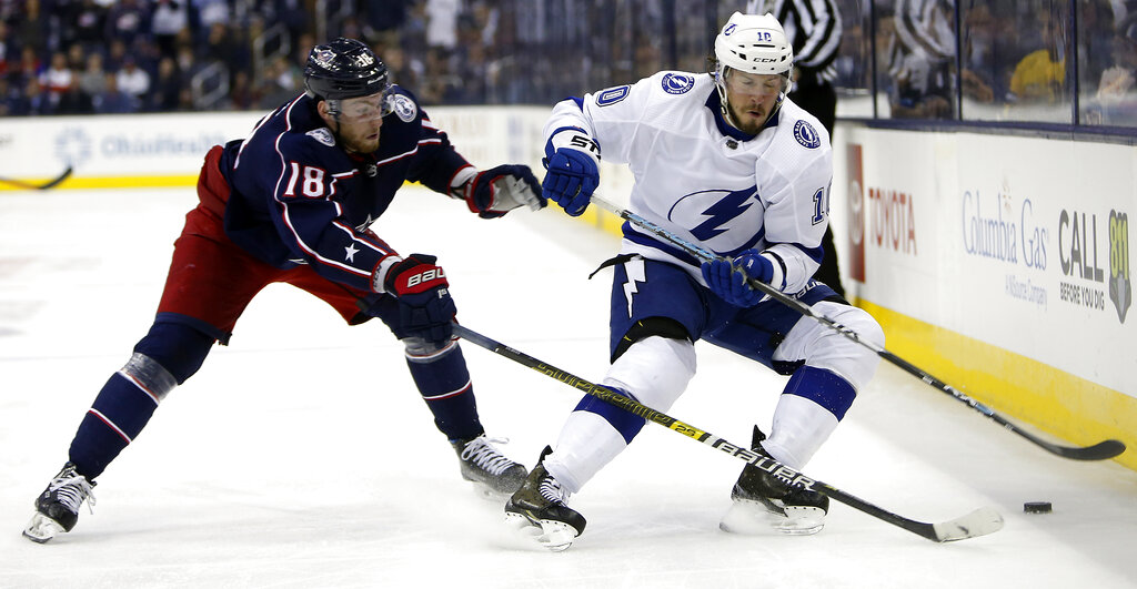 Columbus Blue Jackets' Pierre-Luc Dubois, left, knocks the puck away from Tampa Bay Lightning's J.T. Miller during the third period of Game 4 of an NHL hockey first-round playoff series Tuesday, April 16, 2019, in Columbus, Ohio. The Blue Jackets beat the Lightning 7-3. (AP Photo/Jay LaPrete)
