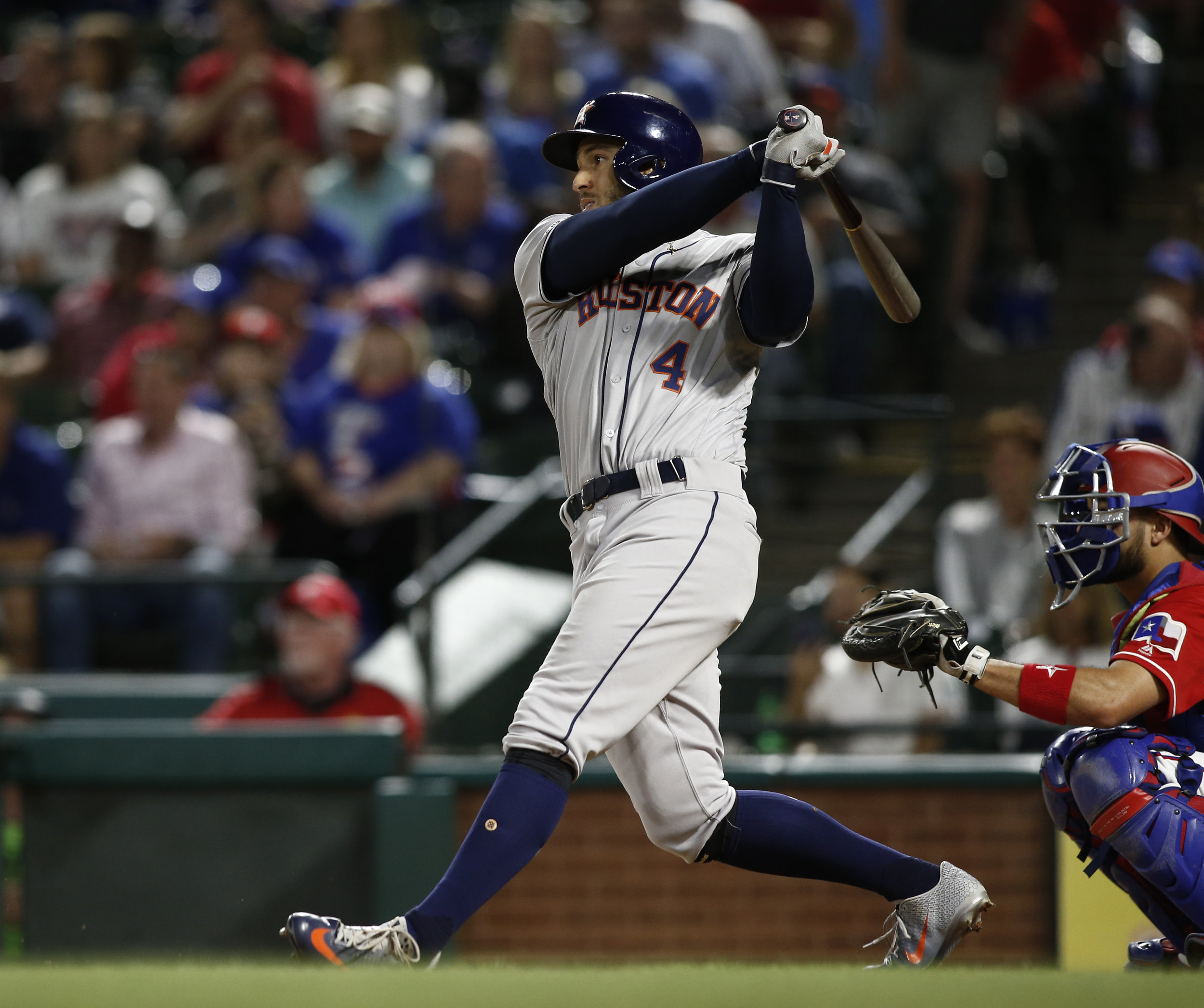 Houston Astros' George Springer (4) hits a two-run home run against the Texas Rangers during the seventh inning of a baseball game Saturday, April 20, 2019, in Arlington, Texas. (AP Photo/Mike Stone)