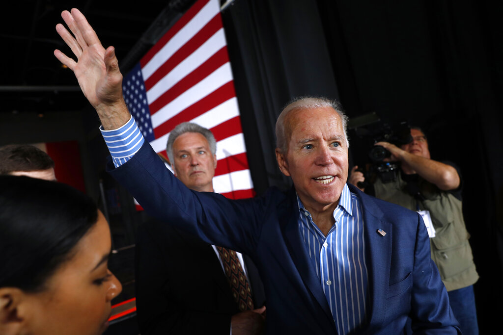 Former Vice President and Democratic presidential candidate Joe Biden waves to supporters after speaking at a rally, Wednesday, May 1, 2019, in Iowa City, Iowa. (AP Photo/Charlie Neibergall)