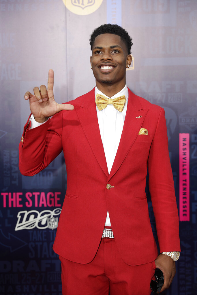 Louisiana State cornerback Greedy Williams walks the red carpet ahead of the first round at the NFL football draft, Thursday, April 25, 2019, in Nashville, Tenn. (AP Photo/Mark Humphrey)