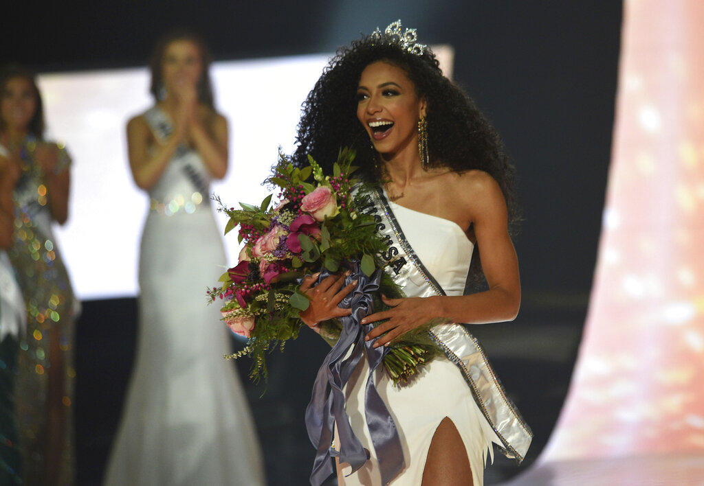 Miss North Carolina Cheslie Kryst wins the 2019 Miss USA final competition in the Grand Theatre in the Grand Sierra Resort in Reno, Nev., on Thursday, May 2, 2019. Alejandra Gonzalez of New Mexico was the first-runner up, and Oklahoma's Triana Browne the second-runner up during the competition. (Jason Bean/The Reno Gazette-Journal via AP)