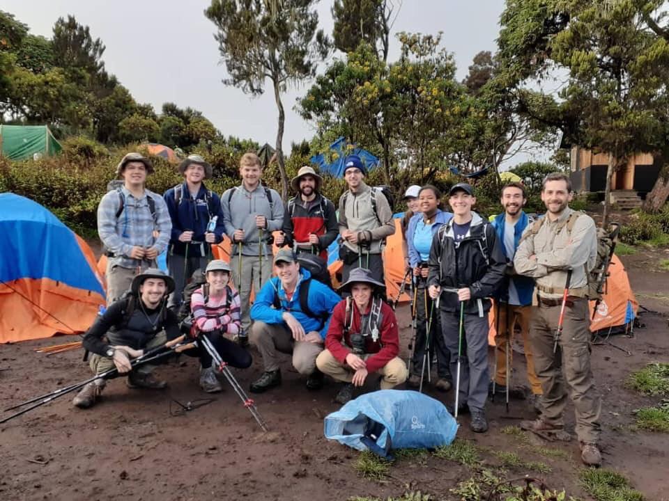 Photo by Rita Plante, Group shot at a campsite during the 2019 Kilimanjaro Trek