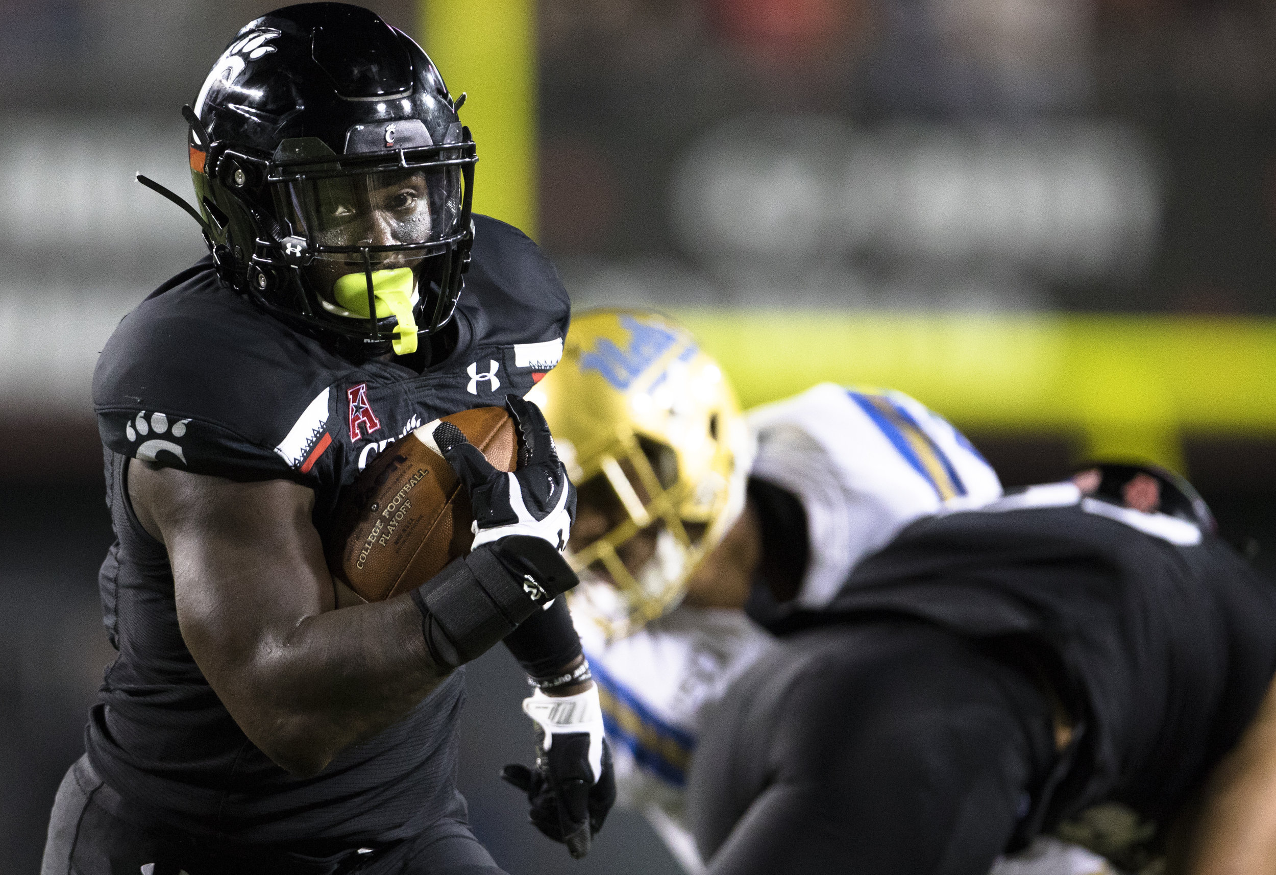 Cincinnati won their first game of the season against UCLA through their impressive play on the ground.  Photo from The Associated Press