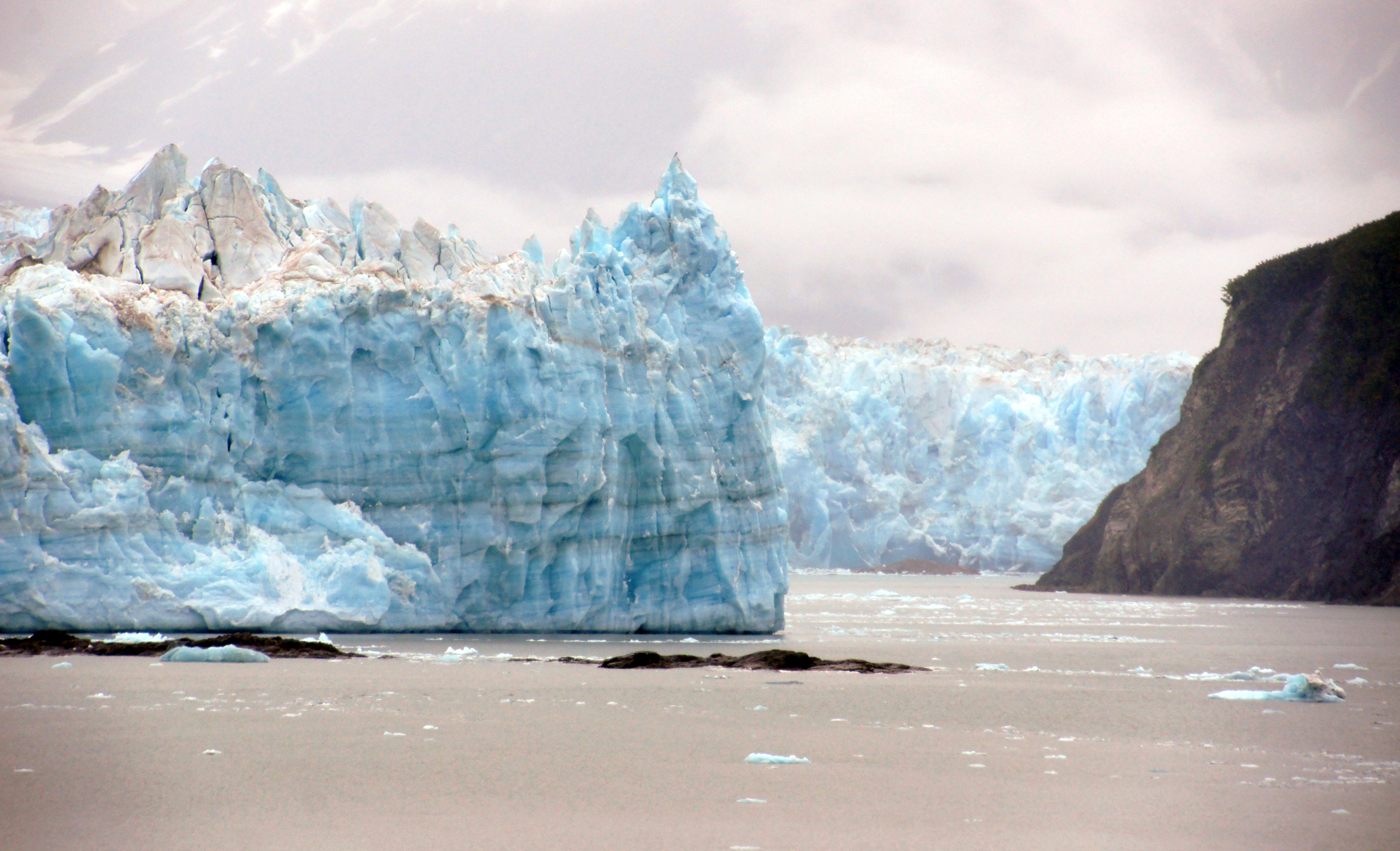 Global warming is one of the world's largest problems the world currently faces, resulting in higher temperatures and melting ice glaciers among other consequences.  Photo by Bernard Spragg. NZ from Flickr Creative Commons