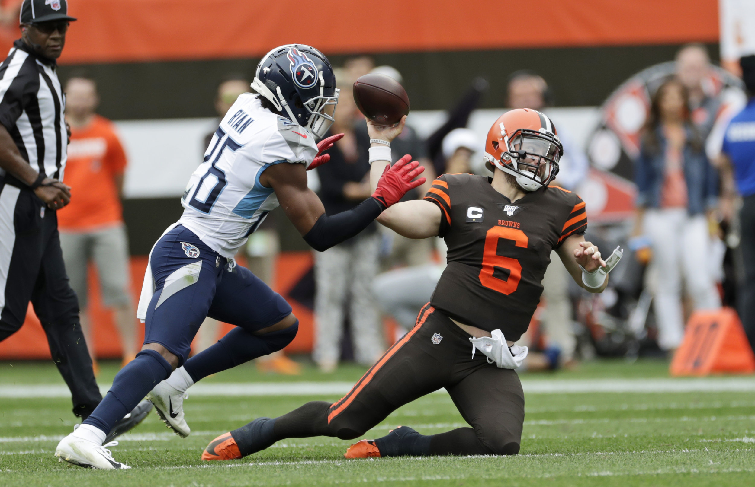 Despite the incredibly high expectations for his sophomore season, Baker Mayfield struggled mightily, throwing three interceptions in the Browns huge loss to the Titans.  Photo by The Associated Press.