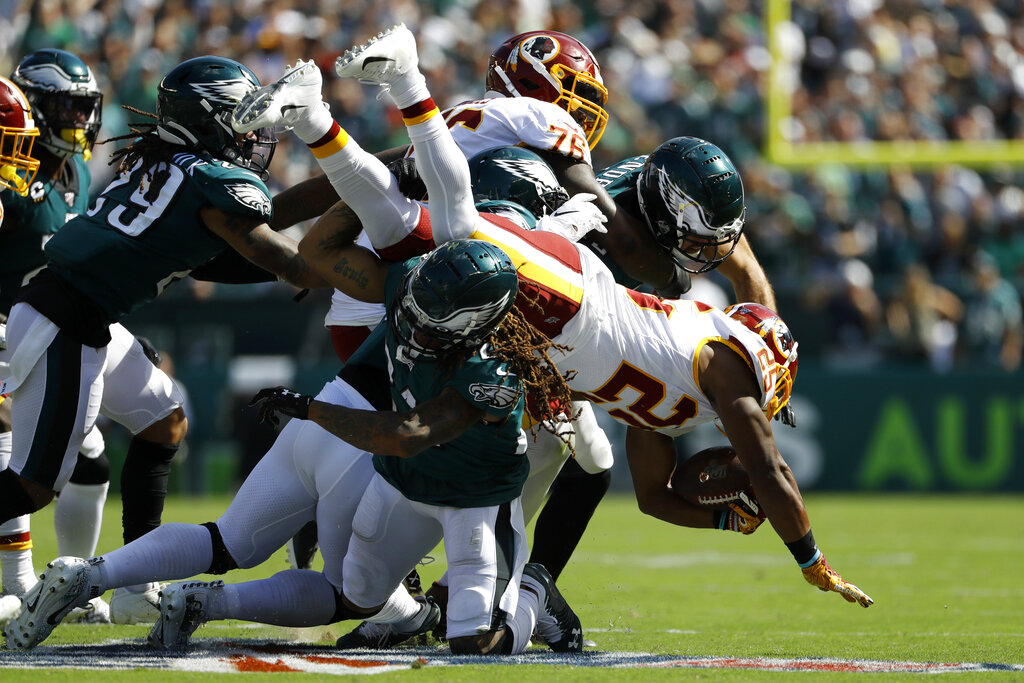 The Redskins' Chris Thompson gets tackled by the Eagles' Ronald Darby during a game last September.   Photo by Michael Perez/Associated Press