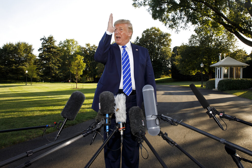 President Donald Trump talks to media before boarding Maine One at the White House in Washington, Friday, Aug. 30, en route to Camp David in Maryland.  Photo by Carolyn Kaster/Associated Press