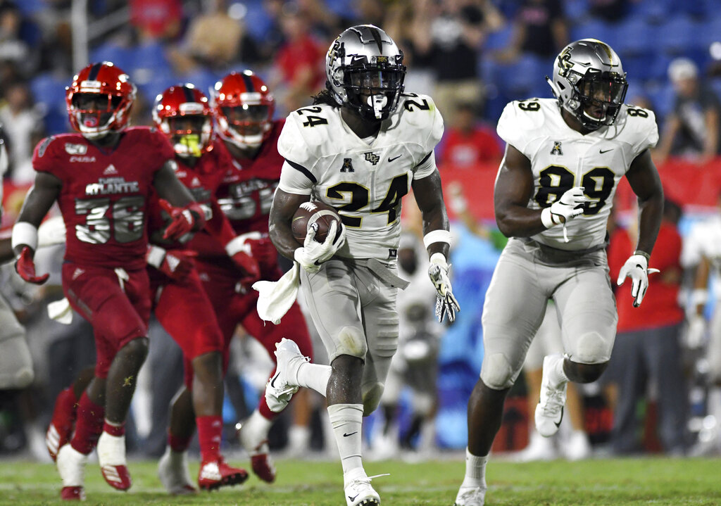 UCF running back Bentavious Thompson (24) breaks free for a touchdown against Florida Atlantic during the second half of an NCAA college football game.  Photo by Jim Rassol/Associated Press