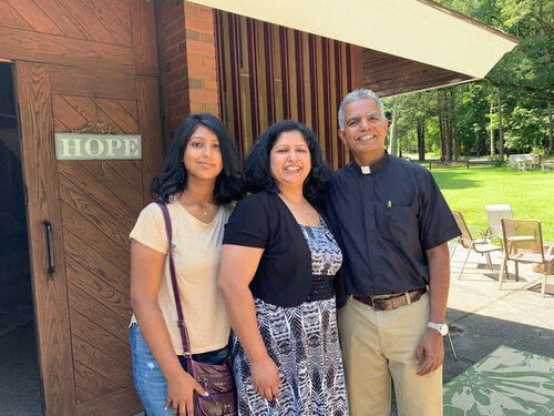 Pastor Gabriel with his wife Sangeetha and their daughter Keren outside of Hope Church.  Photo courtesy of Phil Secke.