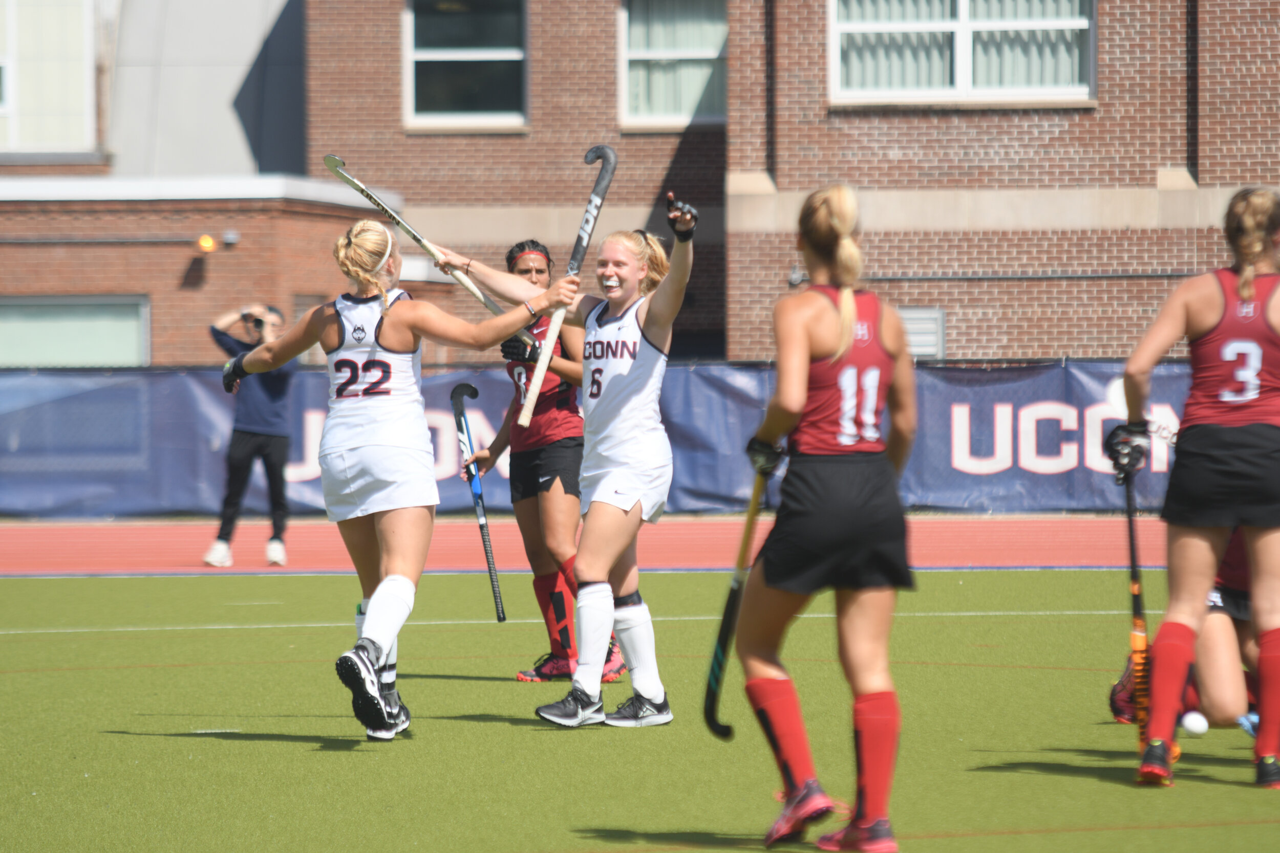 UConn field hockey players celebrating during their win against MSU.   Photo by Maggie Chafouleas, Associate Photo Editor/The Daily Campus