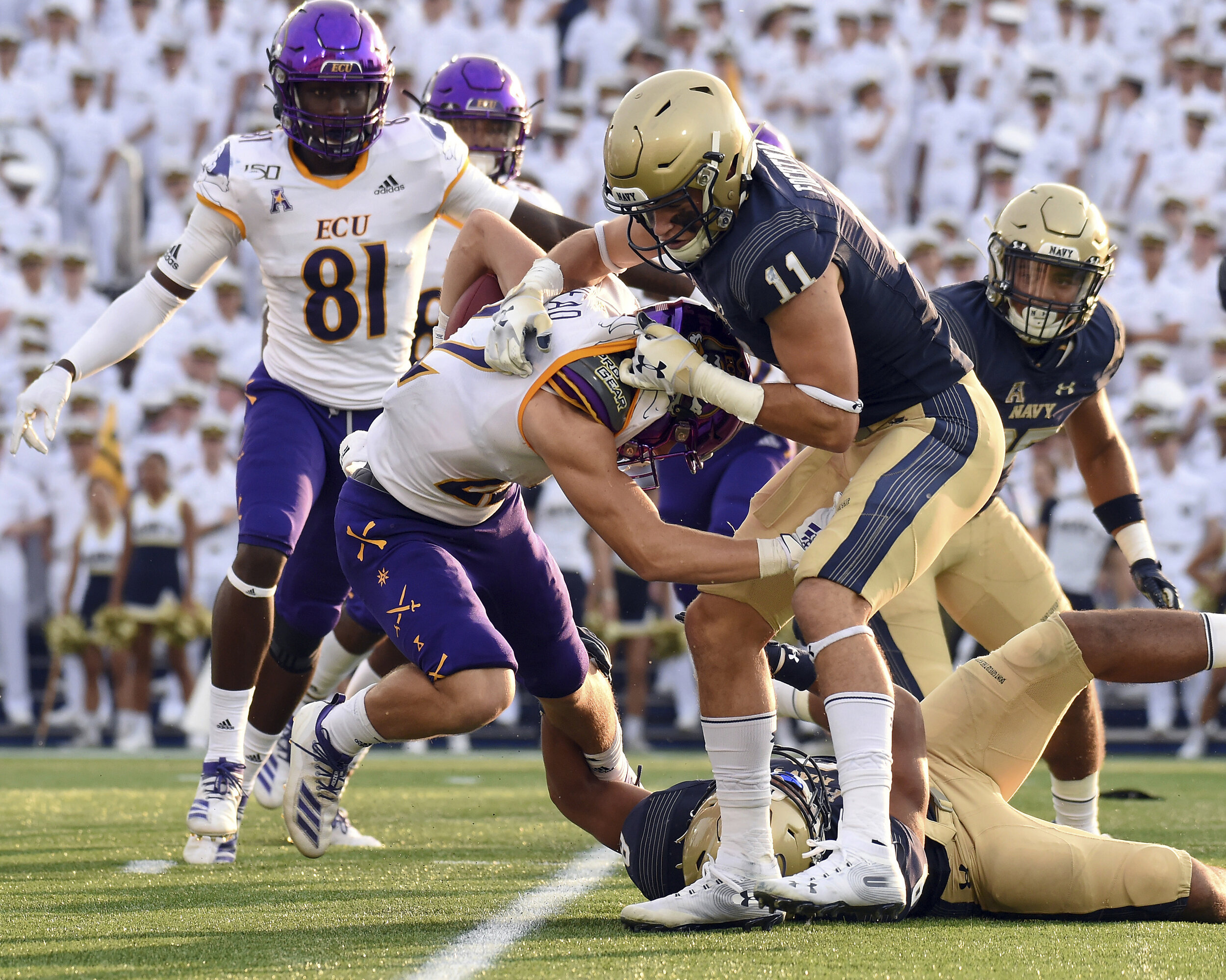 ECU fell to Navy last weekend, allowing Navy running back Malcolm Brown to gain 164 yards on the ground.  Photo from The Associated Press.