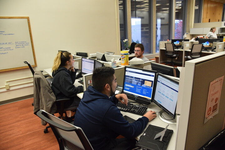 Students at work in HuskyTech offices in the ITE building on campus. Attacks via email scams have occurred recently, with different techniques used by scammers.  File Photo/The Daily Campus