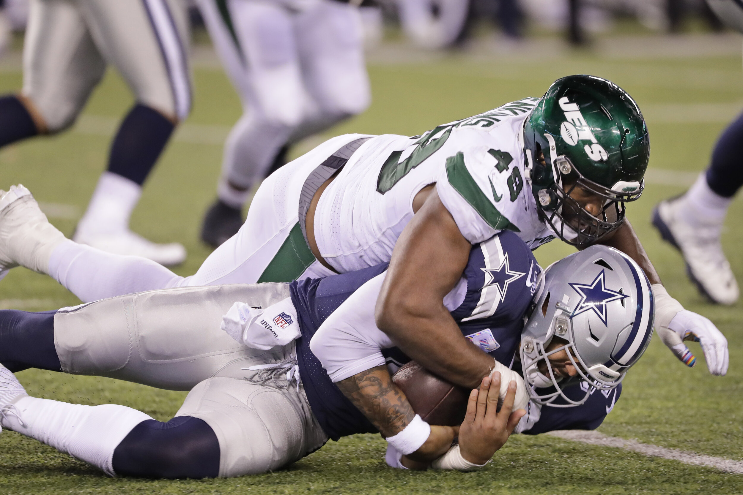 New York Jets' Jordan Jenkins, top, takes down Dallas Cowboys quarterback Dak Prescott during the second half of an NFL football game, Sunday, Oct. 13, 2019, in East Rutherford, N.J. The Jets defeated the Cowboys 24-22.  AP Photo/Frank Franklin II
