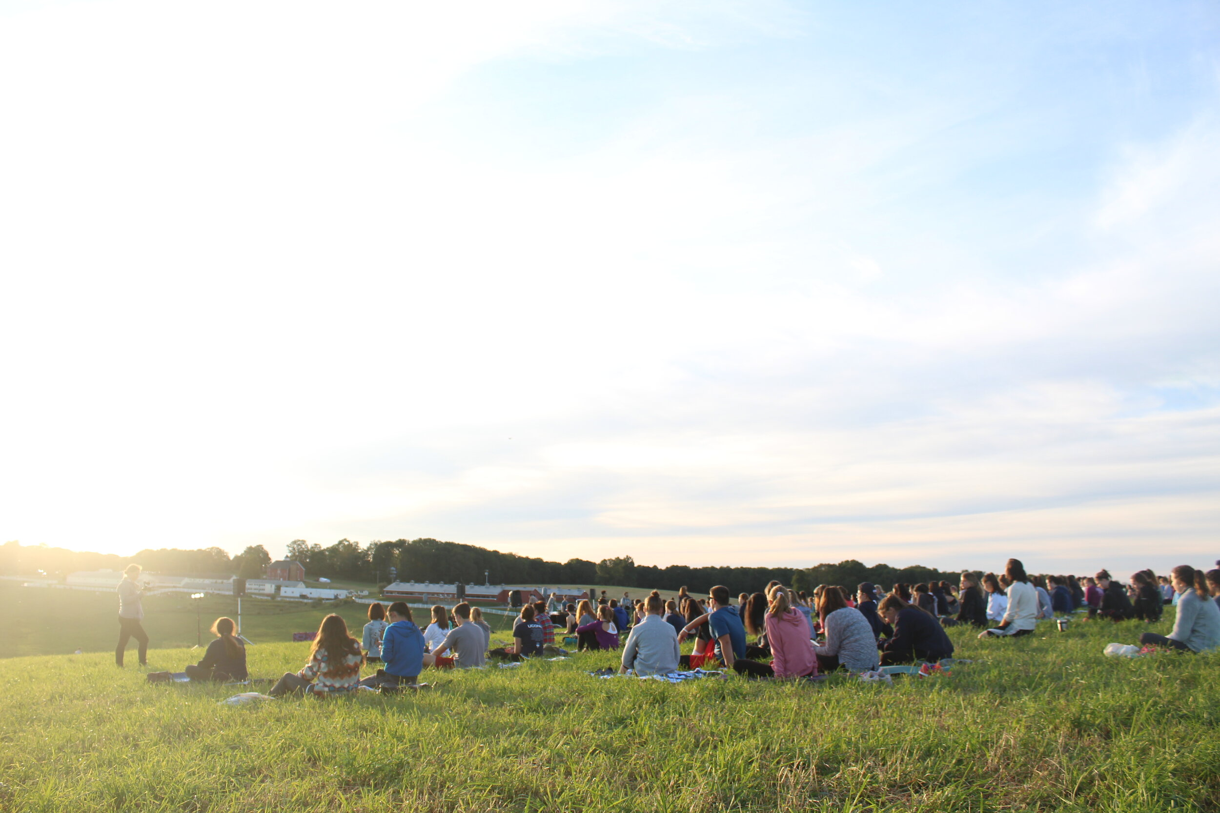 Students participate in Sunset Yoga at Horsebarn Hill on Friday, Sept. 1. The event was hosted by Counseling and Mental Health Services.  Photos by Kimberly Nguyen / The Daily Campus.