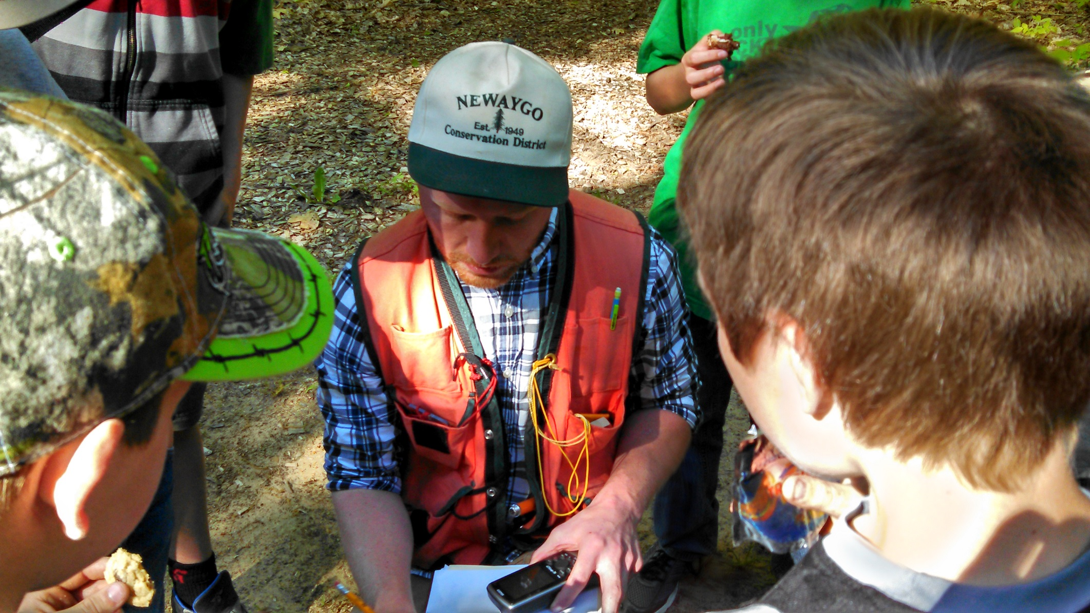 District Forester AJ Smith explains GPS systems to the Newaygo County Boy Scouts