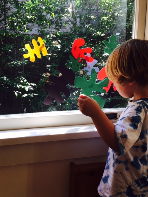 My three year old had fun sticking our cut outs to the window with poster putty.