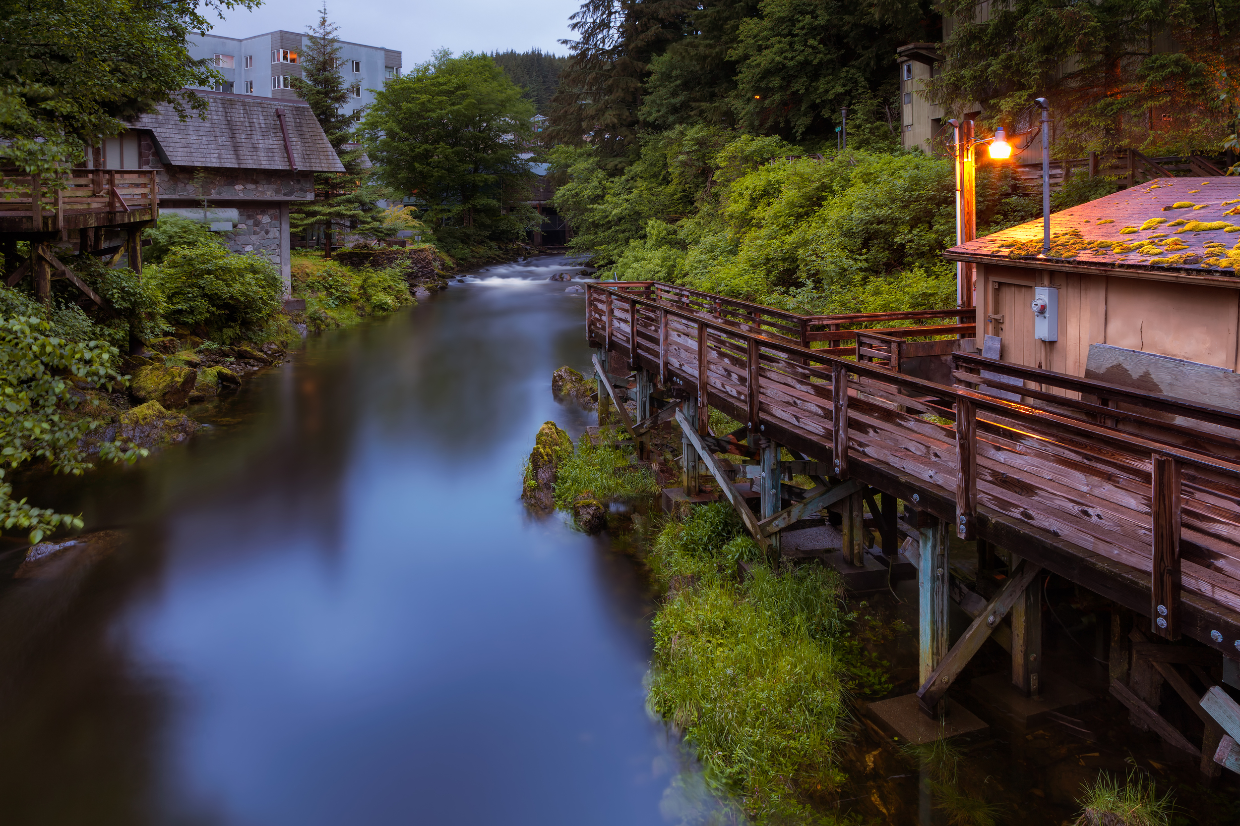 """Far edge of Creek Street. Got this shot with my Canon 5d Mark 2 last night at about 9pm (notice how bright the sky still is).  As pretty and iconic as it is now, during the 1920's Creek Street was actually Ketchikan's red light district, or as they say around here, a place """"Where more men than fish went upstream to spawn."""""""